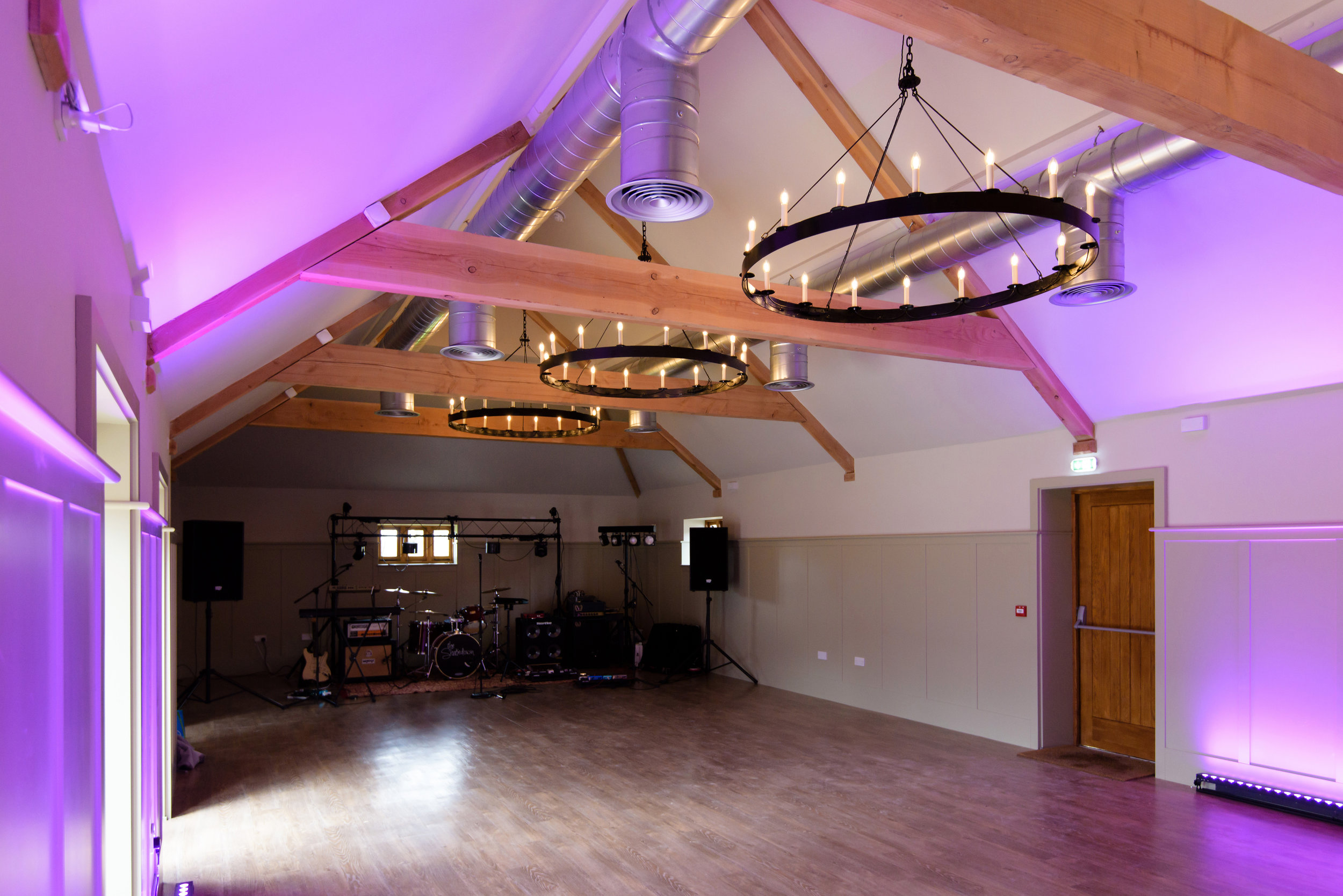 - Originally the farm's cowshed, now a beautifully decorated, fully air-conditioned spacious room with a capacity of 180 guests.Featuring our larger main bar, which will be open throughout the evening, it provides quick service and guests can get right back to the dance floor.