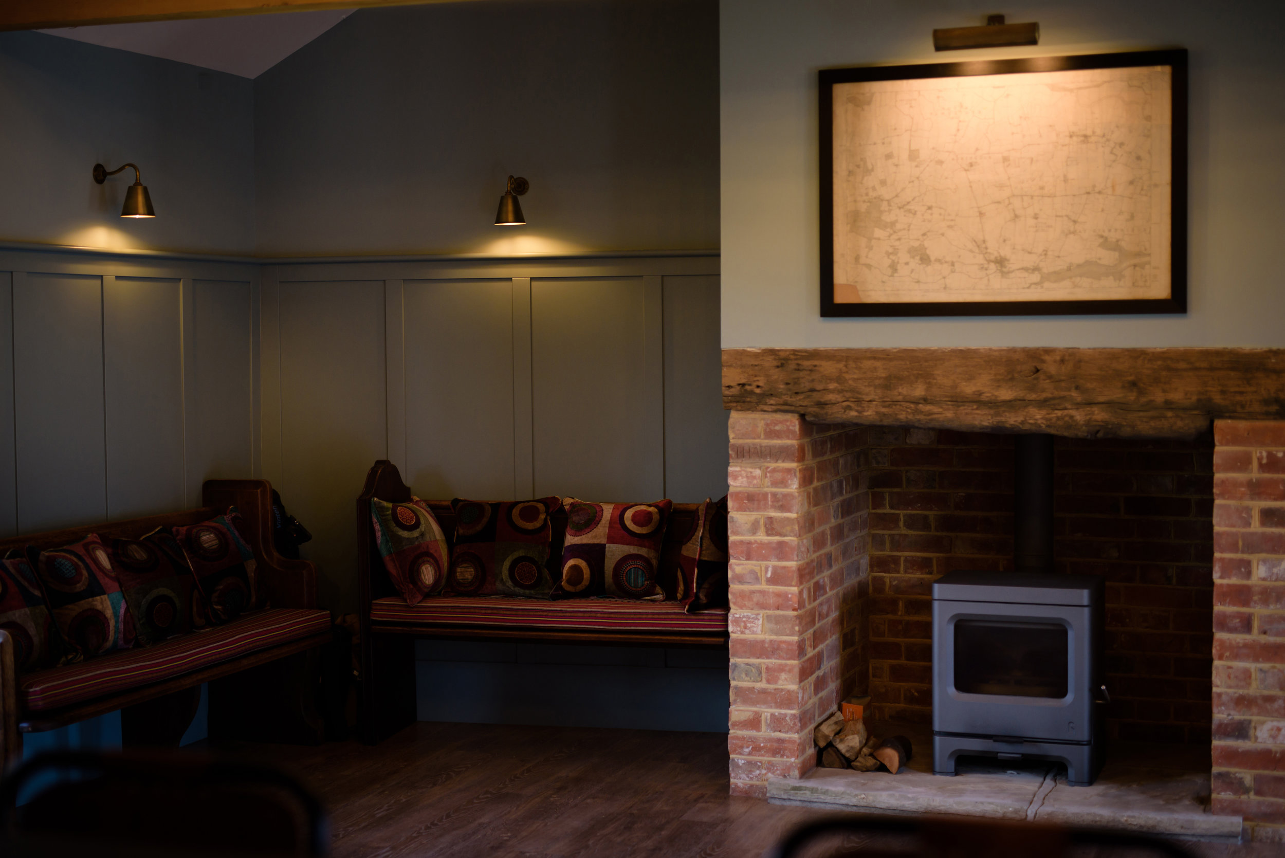 - The Snug Bar has a more chilled atmosphere with comfy chairs and a log burner for those cold winter nights. During the summer the double doors can be opened to provide access to the Pond Garden. The Snug is an area where everyone can relax and enjoy a few drinks.