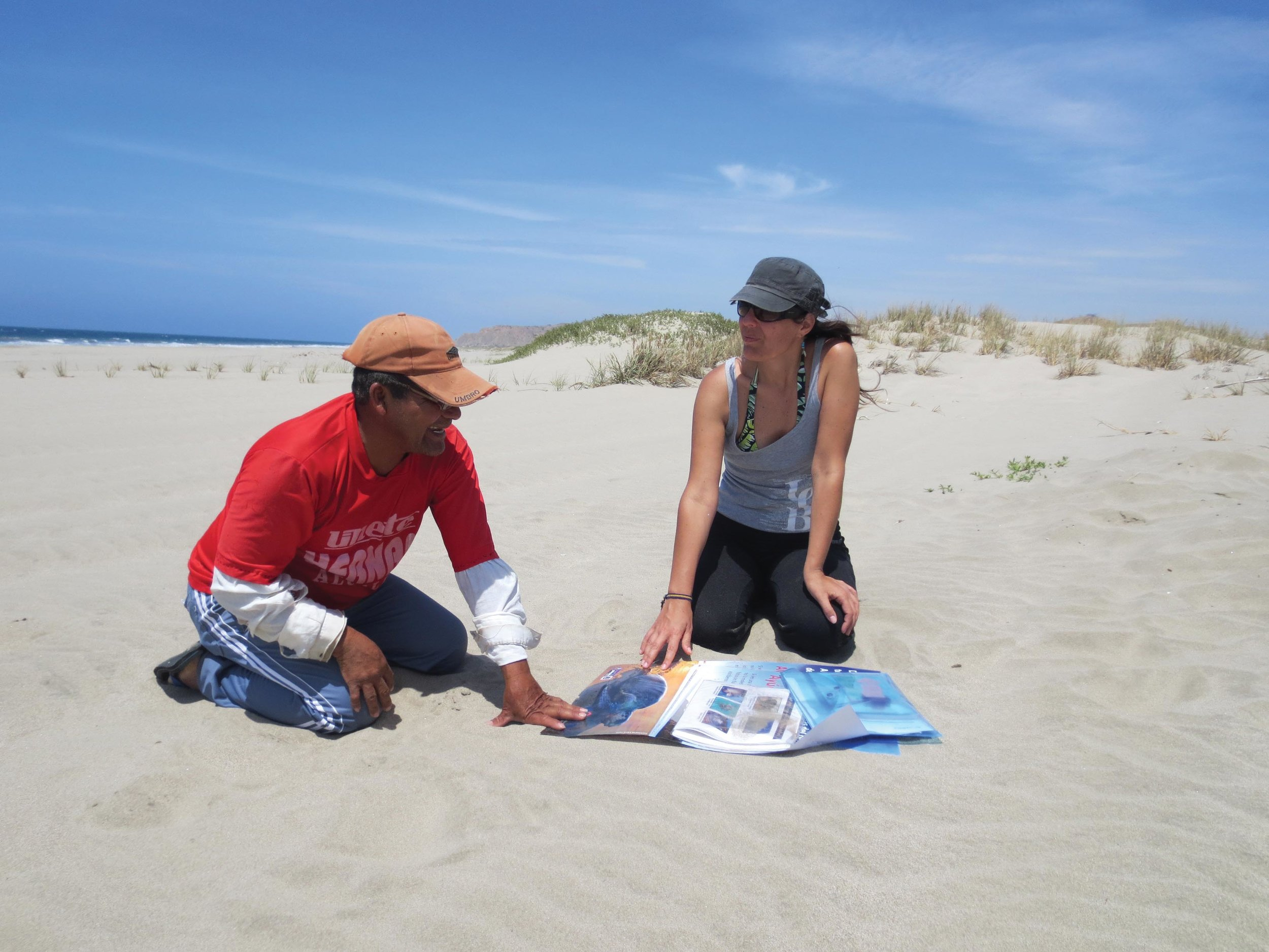 Shaleyla Kelez interviews a local resident about the presence of sea turtles during a survey of Peru's coastline. © ecOceanica