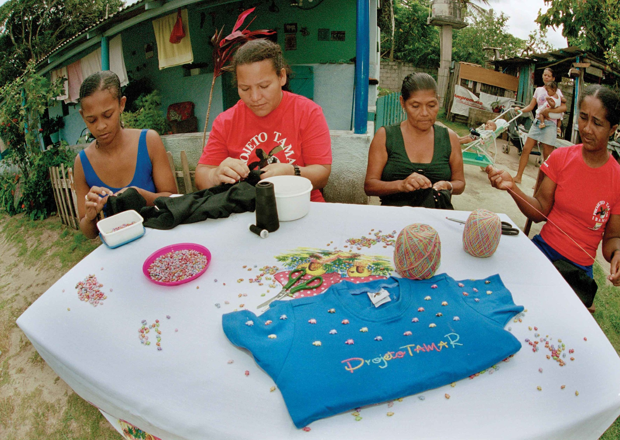 A local community craft group creates handmade t-shirts that will be sold in stores run by Projeto TAMAR. TAMAR's innovative retail program supports community employment and funds conservation programs in coastal communities throughout northern Brazil. © Projeto TAMAR Image Bank
