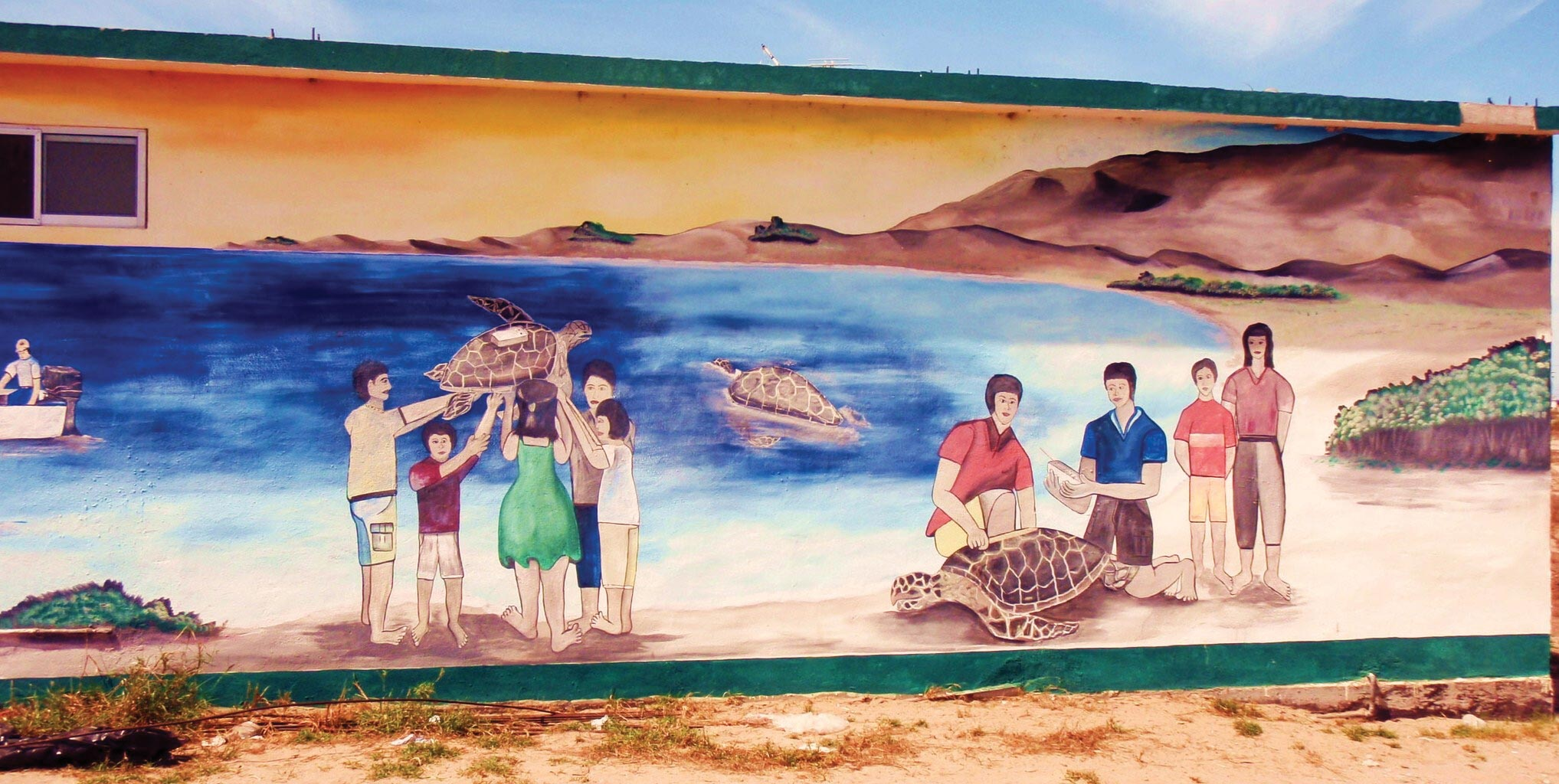 Painted by Marcos Aragon, this mural at the entrance to Puerto Adolfo López Mateos was designed by ProCaguama and Grupo Tortuguero to celebrate the area's local loggerhead population and the potential for sea turtle–based ecotourism. © Andrew J. Schneller