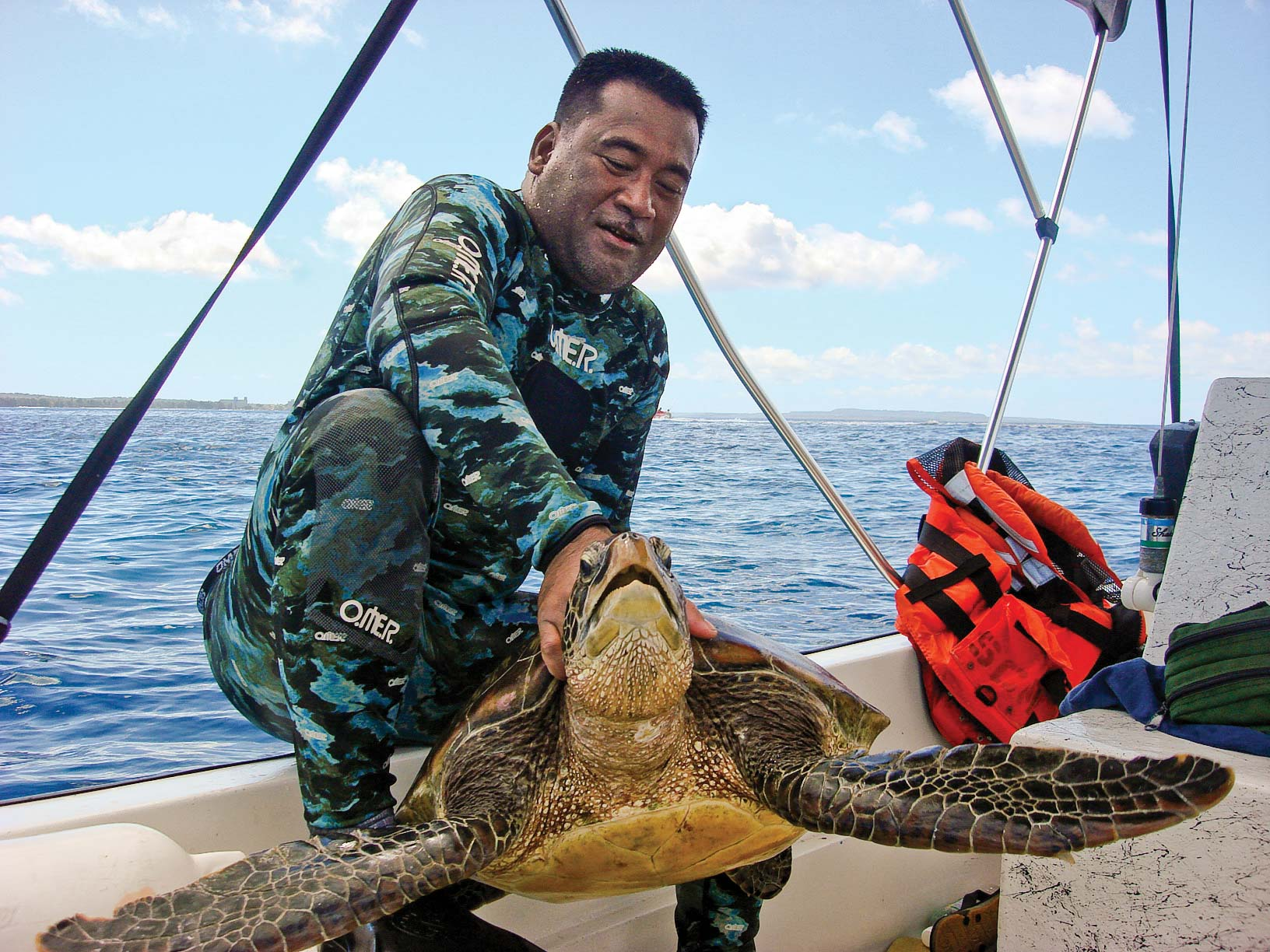 Jessy grew up catching turtles in Micronesia, where they are a traditional food source for his community. Today, he is putting his skills to use by catching turtles for research. © Christopher Alepuyo