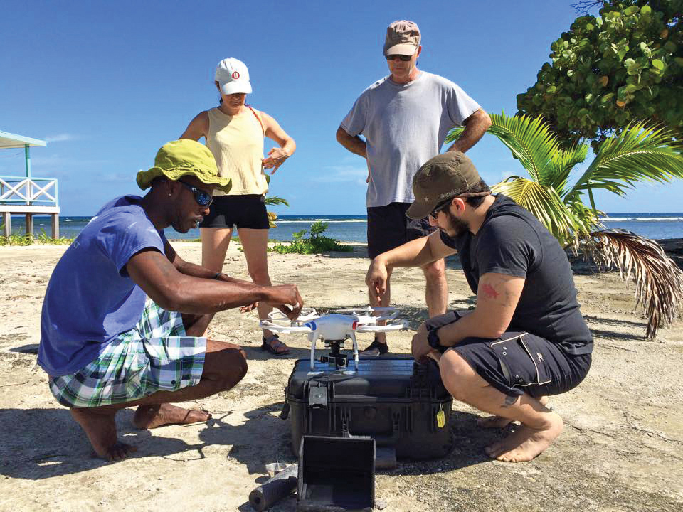 Researchers prepare a quadcopter drone for aerial surveys in Turneffe Atoll, Belize. © KATHI KOONTZ AT