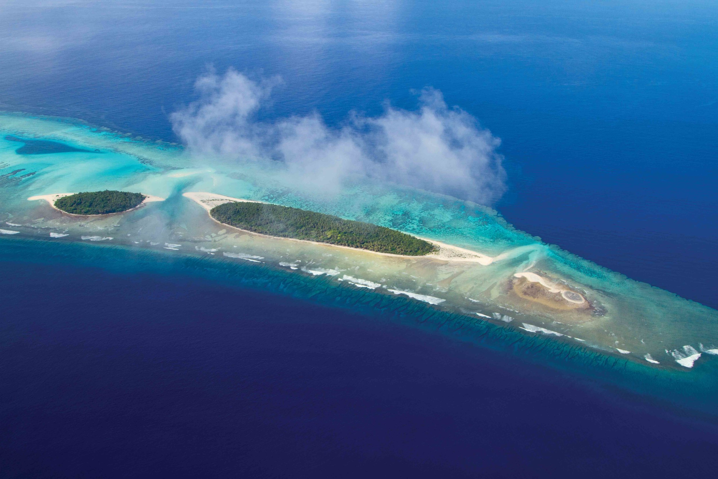 An aerial view of the Crab Islands near Falalop Island in Ulithi Atoll, Federated States of Micronesia, is shown. © Wayne Sentman