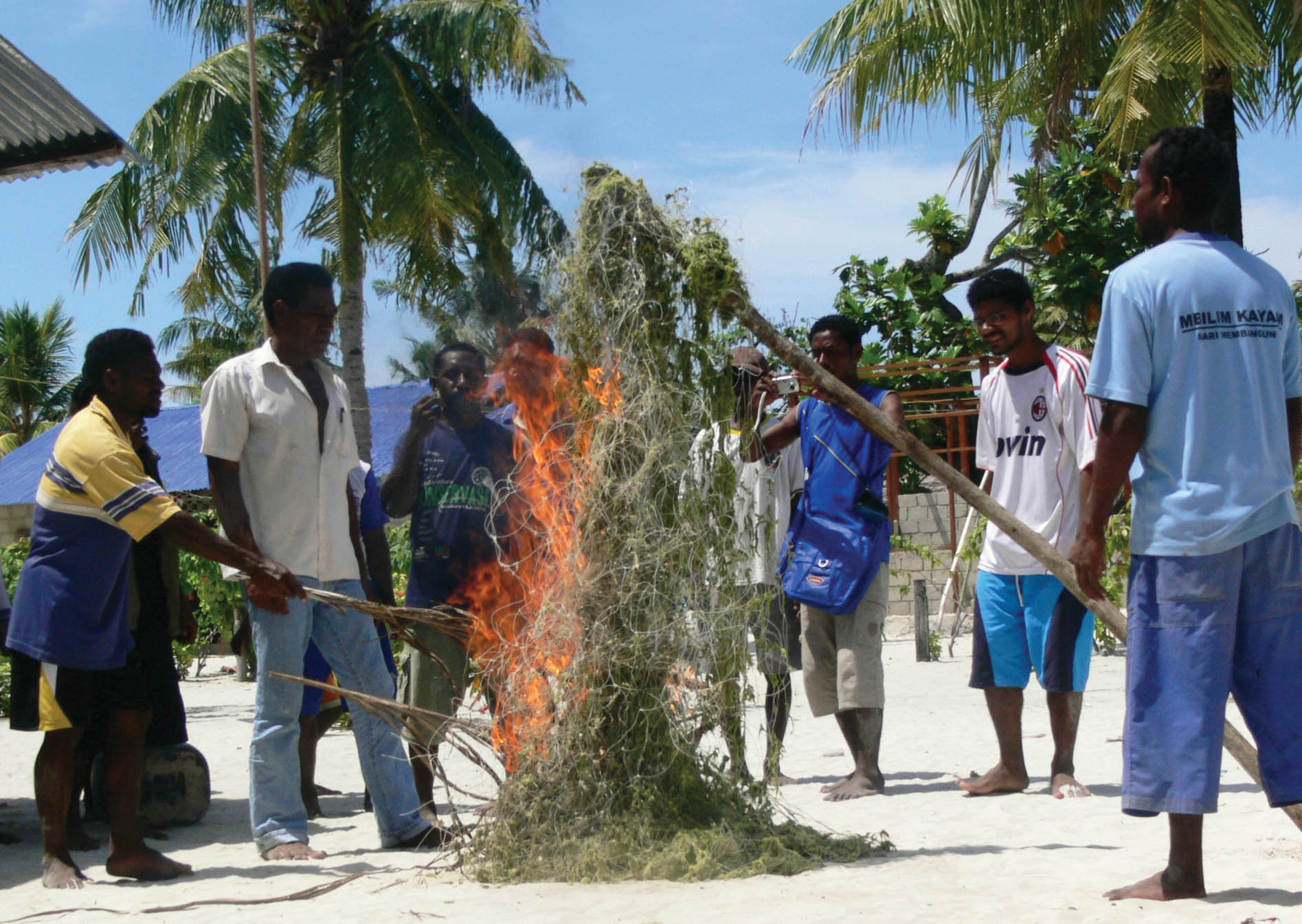 In a symbolic ceremony to express their new commitment to sea turtle conservation, the Ayau turtle hunters burned a net used to capture the turtles. © Conservation International-Indonesia