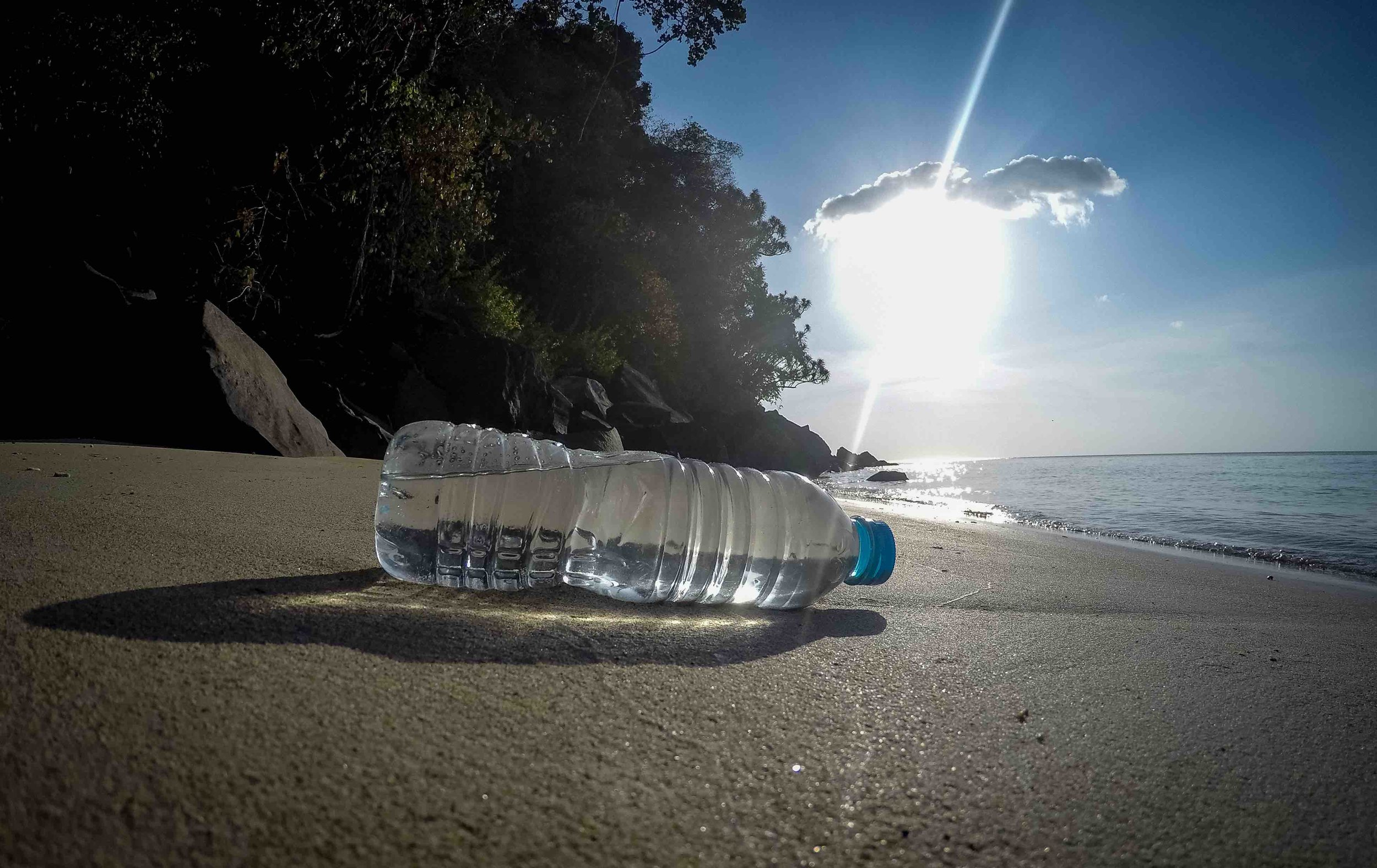 A plastic water bottle on the beach of a remote island in Indonesia. © Morrison Mast