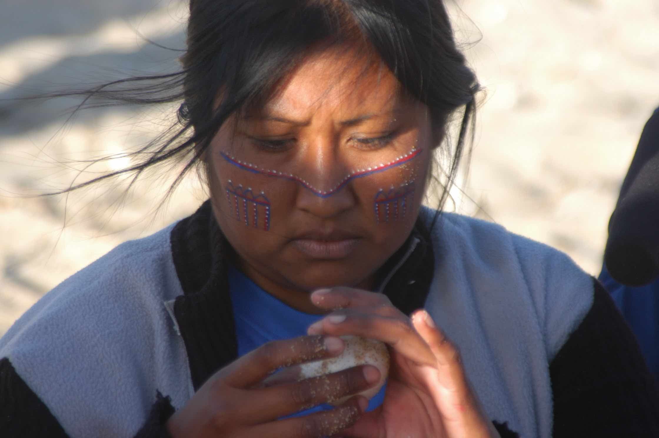 The Seri tribe of Sonora, Mexico, is one indigenous culture that maintains its strong traditional, cultural ties to sea turtles. A four-day ceremony celebrating the ancient leatherback turtle is one of the Seris' most sacred traditions. Since 1981, the Seris had been unable to perform this ceremony in their home community, due to declines in the leatherback population. Mayra Olivia Estrella Astorga (at right) is one of five Seris who, in 2006, traveled across the Gulf of California to the Baja California Sur peninsula to perform the traditional ceremony with leatherback hatchlings. Ancient cave paintings—including illustrations of turtles—found near Loreto in Baja California Sur were likely created by Seri ancestors more than 750 years ago. © Ocean Revolution