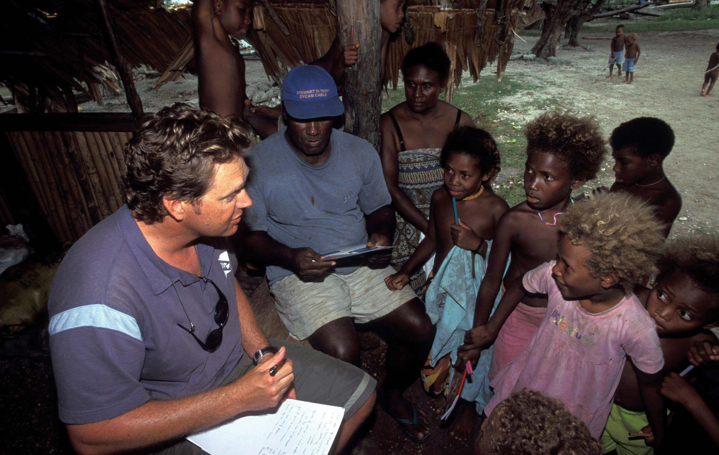 Gathering community support for conservation projects on the island of Malaita in the Solomon Islands, cetacean biologist Benjamin Kahn speaks to community members of Fanalei Village about local marine life. © DAVID WACHENFELD / TRIGGERFISH IMAGES