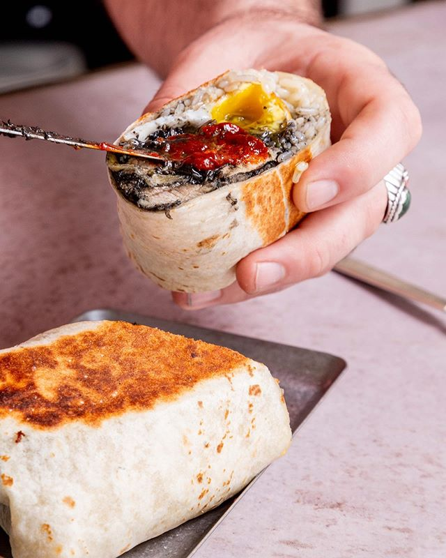 Start your day of with a Filipino sisig burrito with sizzling pork, squid ink, poblano, rice & duck egg 🍳 Brunch at 11:00 then the party goes all night long! 📸 @nickmurway