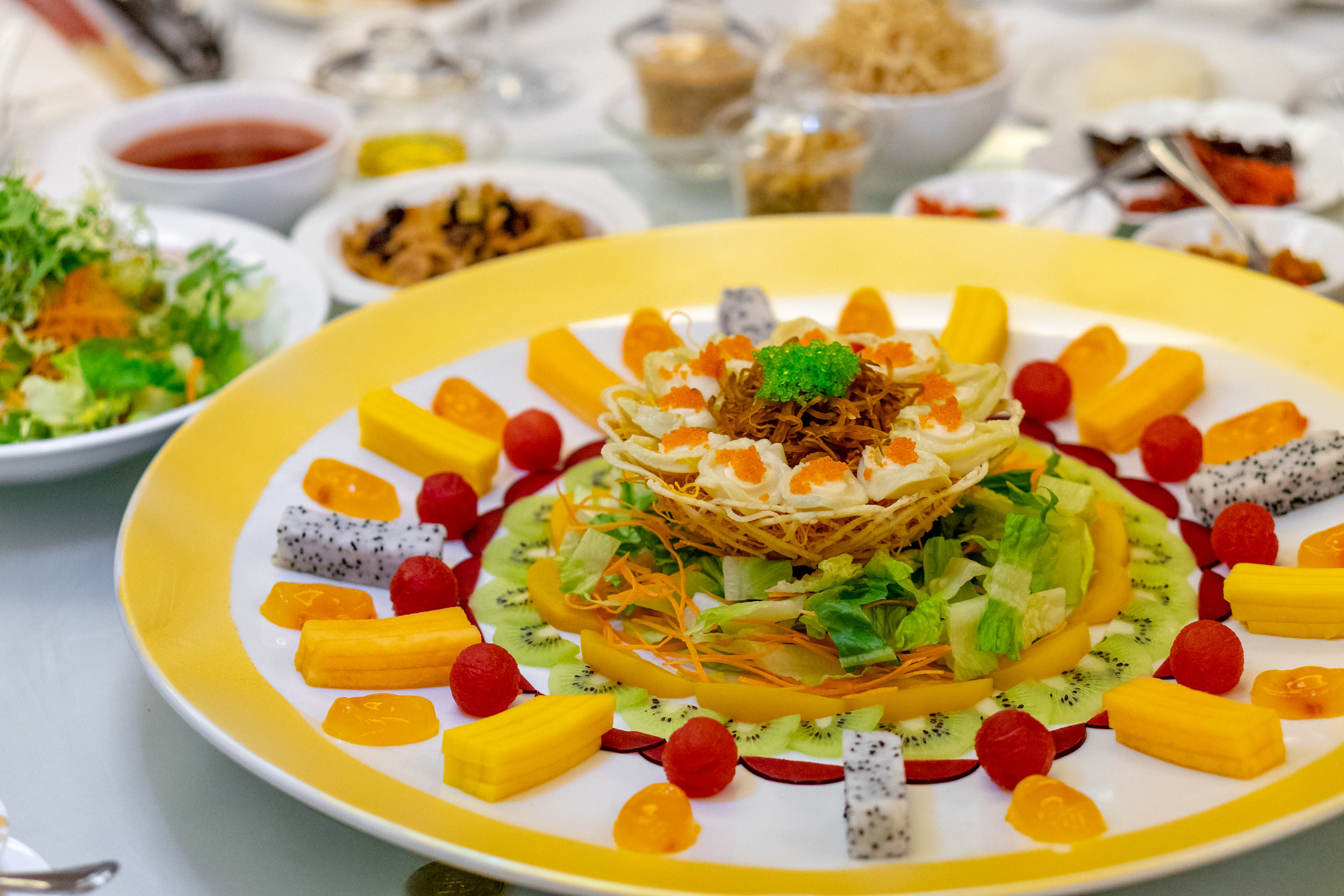 Fruitful Abundance Yu Sheng with Whole Abalone in Raspberry and Sour Plum Sauce 果运当头鱼生
