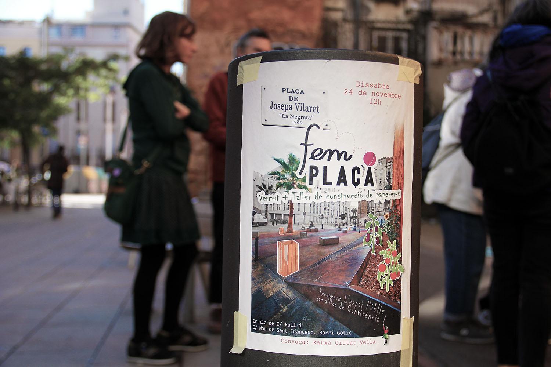 A recent activity of Fem Plaça is announced through posters in the neighbourhood.