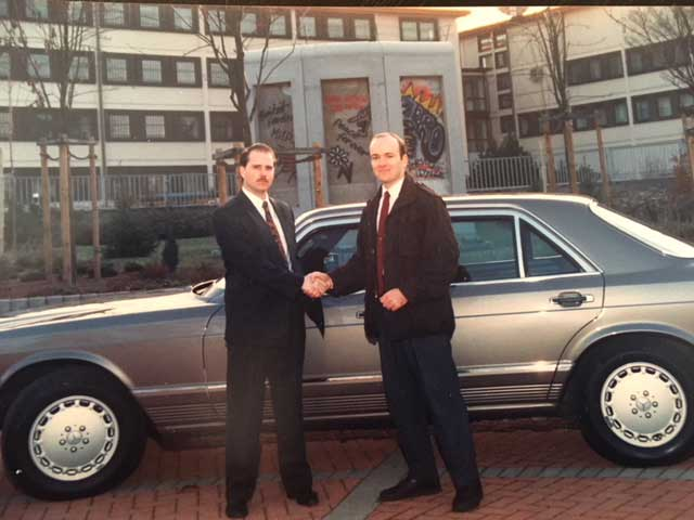 Me on the left and Kevin (my backup driver) standing in front of the recently torn down portions of the Berlin Wall. We put a lot of autobahn miles on that armored Mercedes.