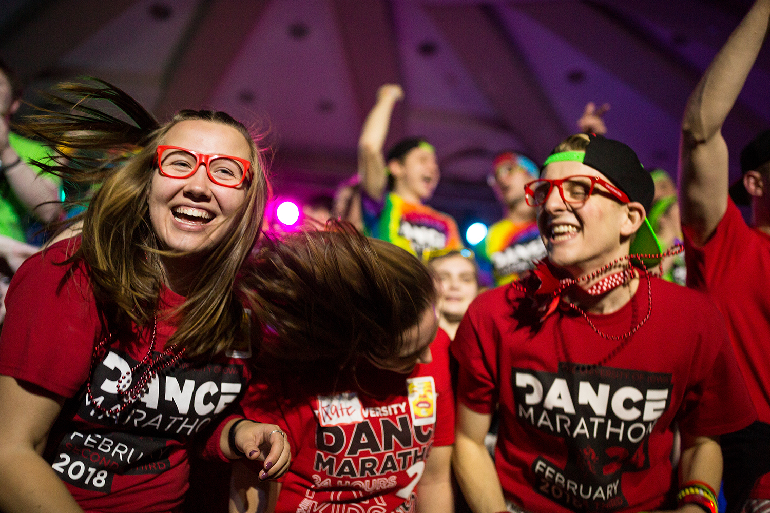 Dance marathon participants dance on stage during the ninth hour of the University of Iowa's 24th Annual Dance Marathon, on Saturday, Feb. 3, 2017.