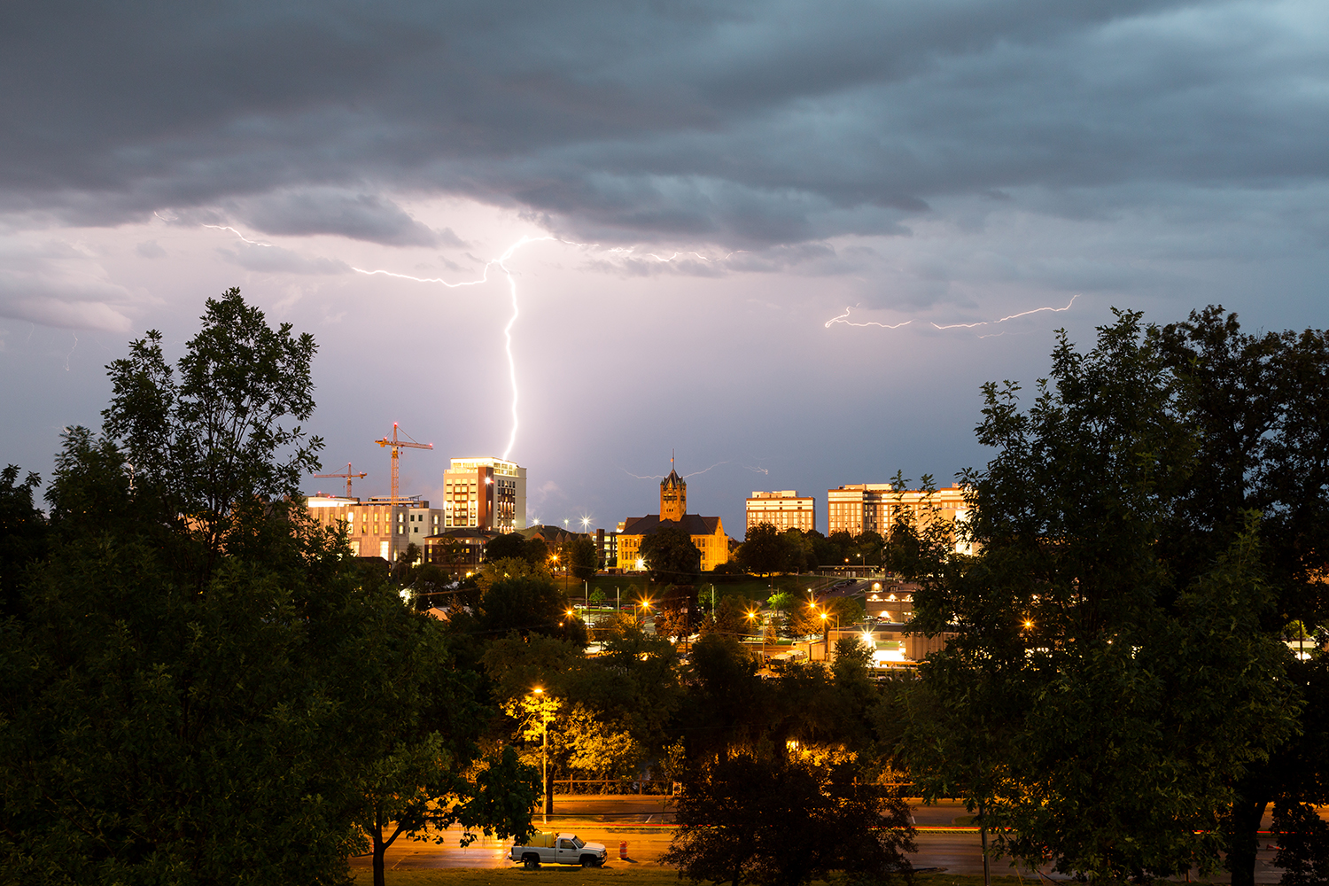 Lighting strikes a building in downtown Iowa City on Tuesday, Aug. 28, 2018.