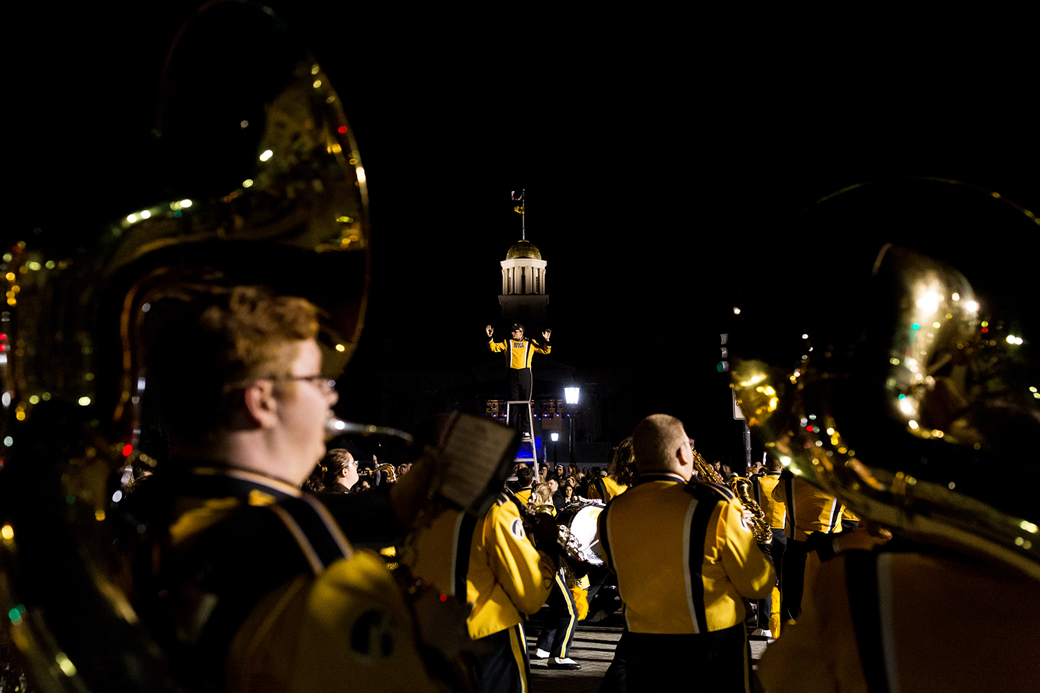 A member of the University of Iowa Marching Band directs the band during the 2018 Homecoming Parade in Iowa City on Friday, Oct. 19, 2019.