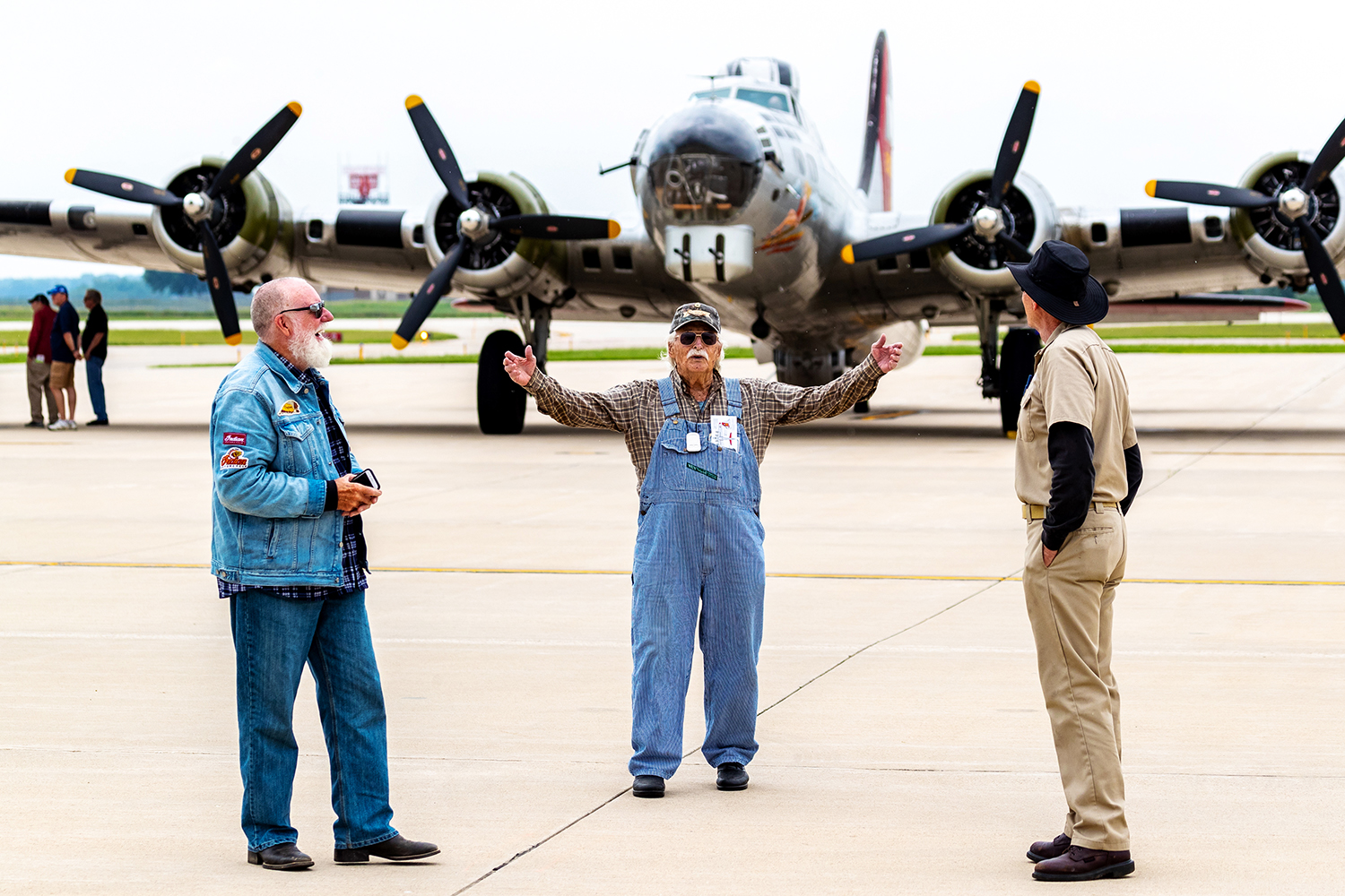 Robert H. Clark of Cedar Rapids shares a story with the crew of the Experimental Aircraft Association's B-17G bomber 'Aluminum Overcast' at the Eastern Iowa Airport in Cedar Rapids on Tuesday, June 18, 2019. Clark flew 53 missions as a ball turret gunner on B-17s while assigned to the 322nd Bomb Squadron, 91st Bomb Group at Bassingbone Air Base in England during World War Two. (David Harmantas/Freelance)