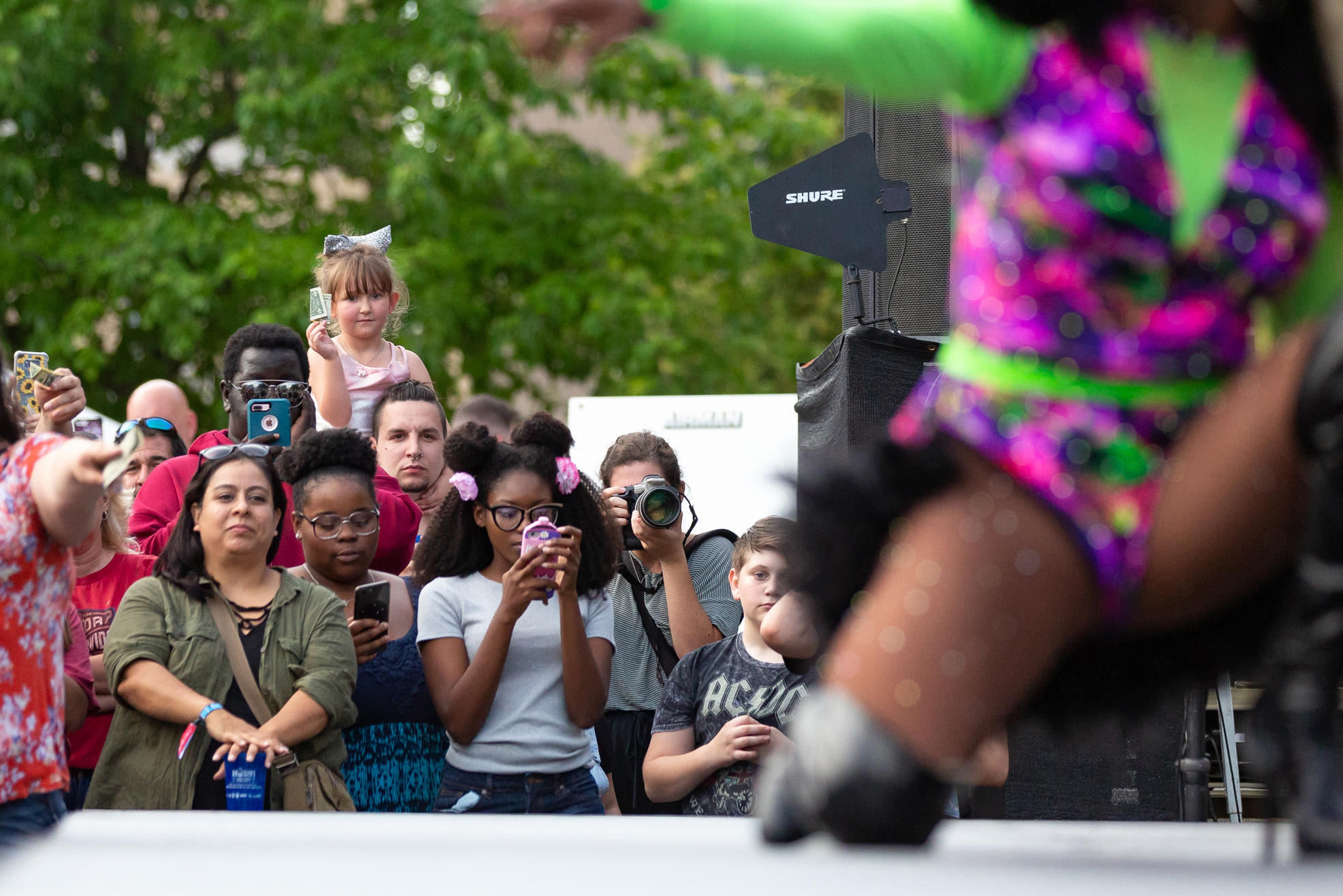 Festival goers watch a drag queen performance during the Downtown Block Party in Iowa City on Saturday, June 22, 2019.