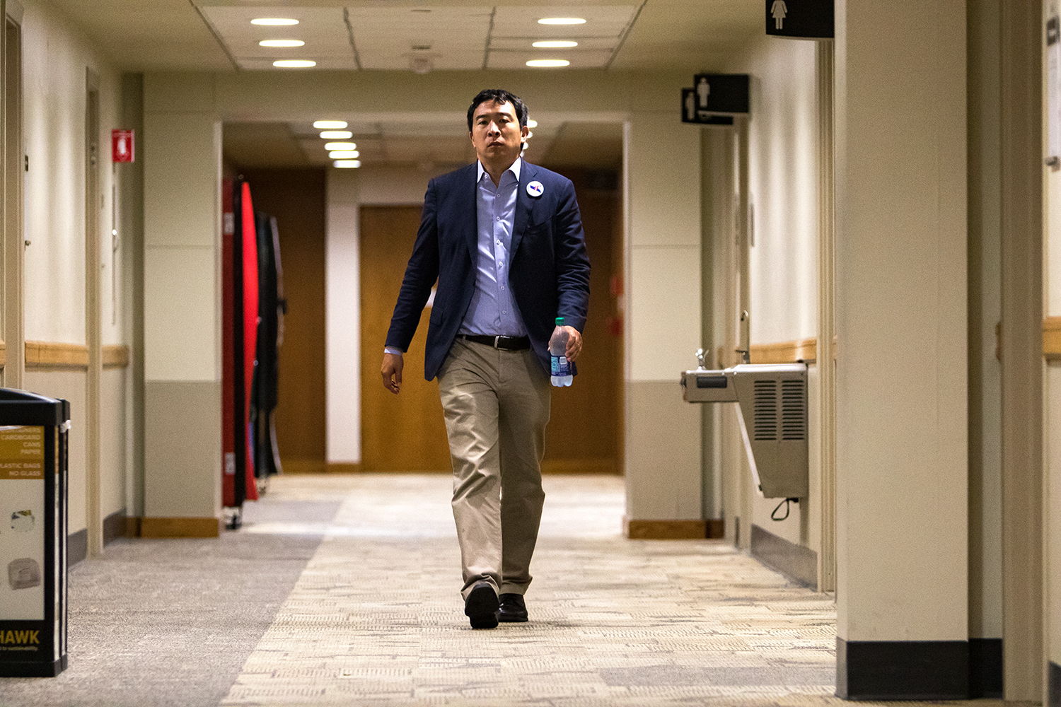 Democratic presidential candidate Andrew Yang walks down a hallway in the Iowa Memorial Union on the University of Iowa campus before an appearance sponsored by the college Democrats on Monday, Sep. 24, 2018.