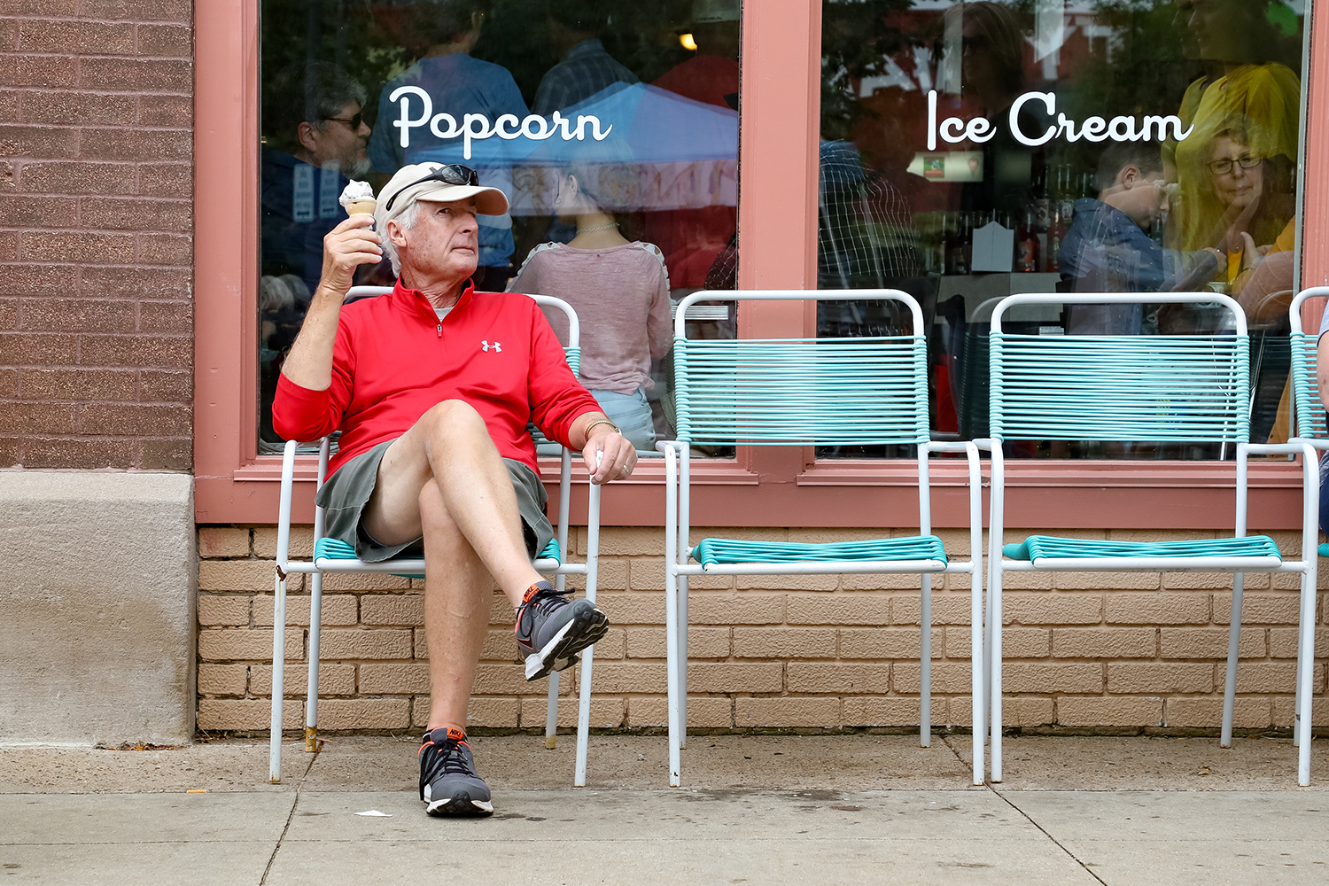 Robert Buckley of Marion, IA enjoys an ice cream cone while watching people walk by during the New Bohemia Arts Festival in Cedar Rapids, IA on Sunday, Sep. 1, 2019.
