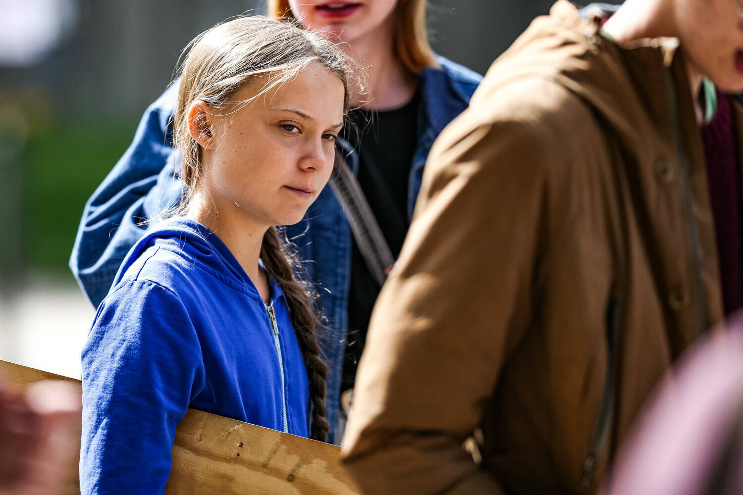 Swedish climate activist Greta Thunberg walks down Iowa Ave. after speaking at the Iowa City Climate Strike in downtown Iowa City on Friday, Oct. 4, 2019.