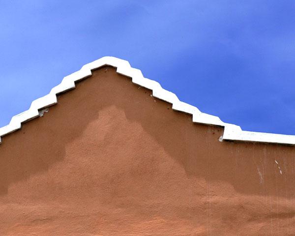 CARIBBEAN HOUSE, ORANGE AND WHITE ON BLUE