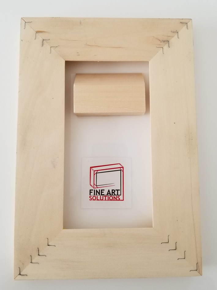 French Cleat mounting solution example 2 (the back of the print shown here). Attach the small wood piece to the wall and simply slip the print over it for an interlocked, secured wall hanging.