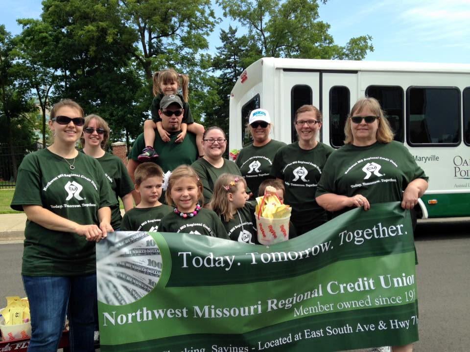 "Group of people holding a sign that says, ""Today, tomorrow, together. Northwest Missouri Regional Credit Union"""