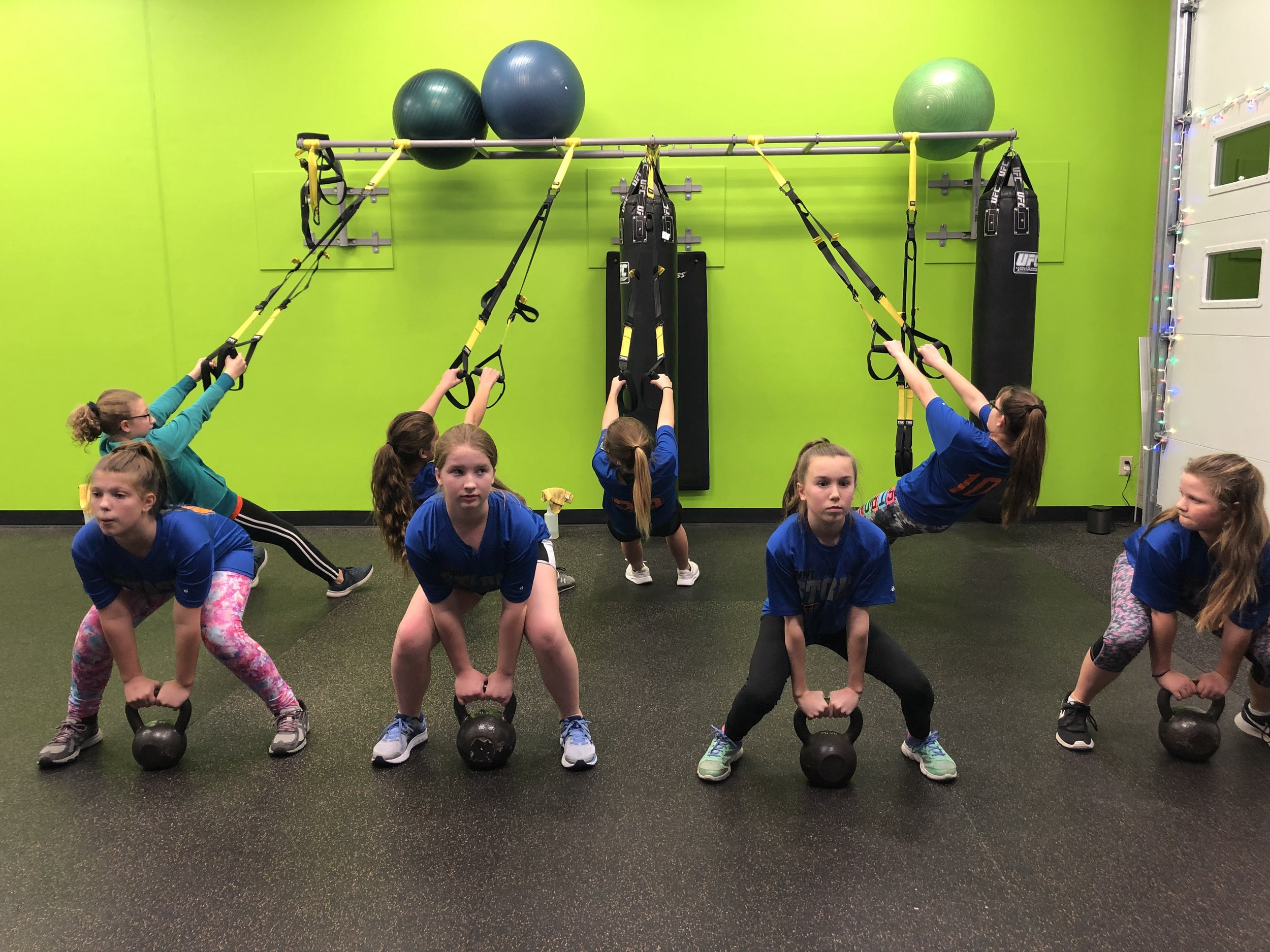 trufit-kettlebell-personal-group-training-sports-performance-gym-valparaiso-workout-fitness-trx-squat.jpg
