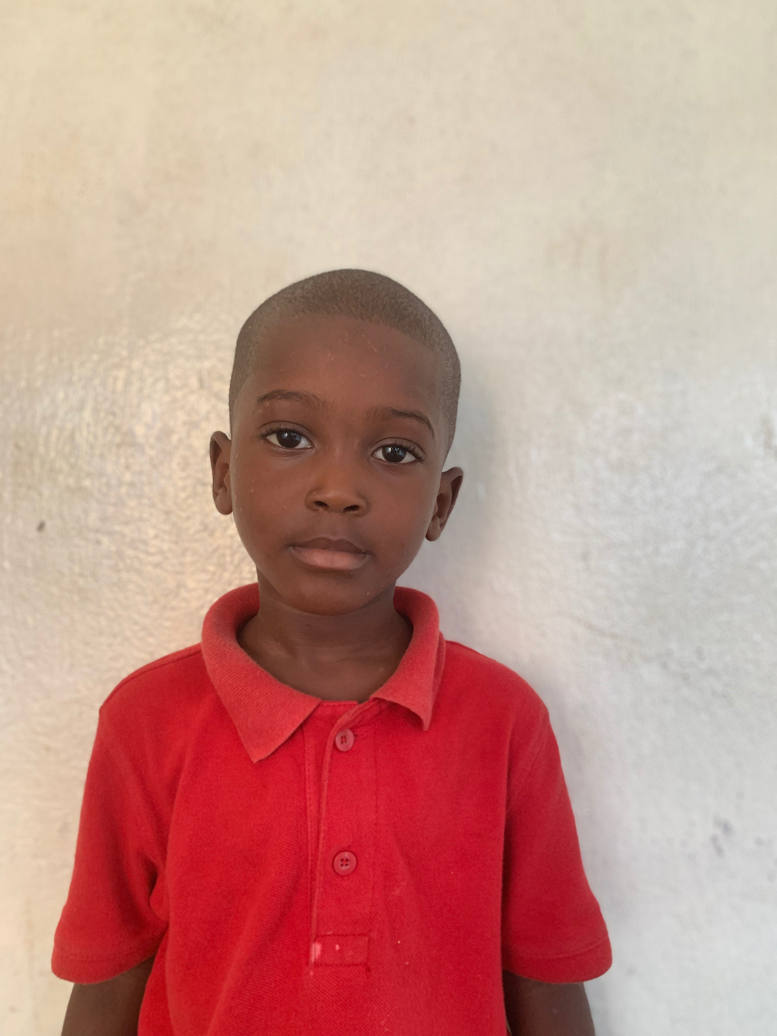 Hello, my name is David Fokofo. - David is a 3-year-old boy.David lives with his parents, two brothers, and a sister; and loves dogs, football, and the color blue.