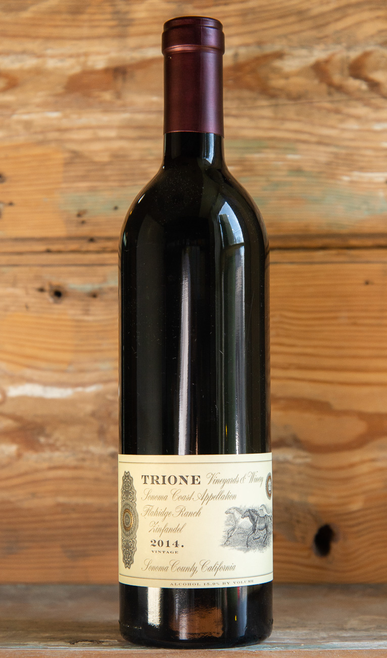 Trione Flatridge Ranch Zinfandel 2014 - Origin: CaliforniaRetail: $39.95 | Sale: $35.95Flatridge Ranch is a secluded parcel in the Coastal mountain range, west of the Rockpile AVA. Here the Trione family planted a 10 acre vineyard of unique Zinfandel vines called Saint Peter's Church. Aromas of briarwood and pipe tobacco give way to blackberry pie, toasted macaroons, and plums. The palate is velvety, supple and rich with a long, satisfying finish. This Zinfandel, a Sonoma County classic, will continue to age for many years to come.100% Zinfandel