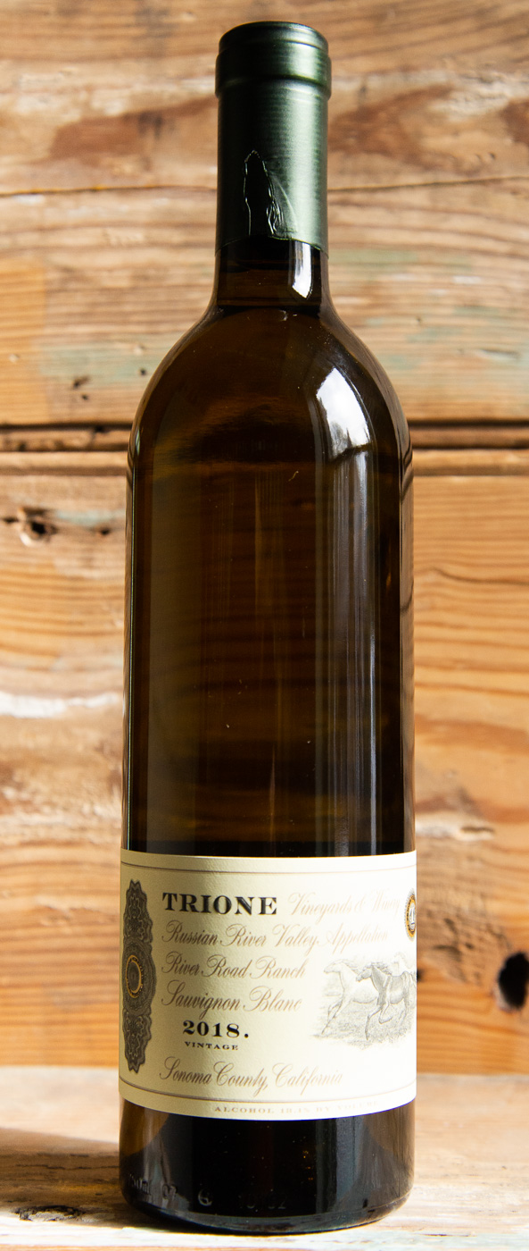 Trione Sauvignon Blanc River Ranch 2018 - Origin: CaliforniaRetail: $22.95 | Sale: $20.65The Trione family has farmed in Sonoma County for three generations. In 2005 they established Trione Winery, designed specifically for crafting small lots of wine from their estate grapes grown in the Alexander Valley, Russian River Valley and Sonoma Coast appellations. River Road Ranch is a jewel in the Russian River Valley Appellation. It is 115 acres in the rolling hills of the valley at a location where the river makes a westerly turn towards the Pacific Ocean. Their well-drained soils are perfect for growing world class Sauvignon Blanc and this wine is the perfect example. White peaches, nectarines and mandarin zest are the first hints on the nose. The acidity and fruit expression on the palate are in perfect balance. This wine is mouth-watering and leaves one craving fresh oysters, sourdough baguettes, or aged gouda.100% Sauvignon Blanc