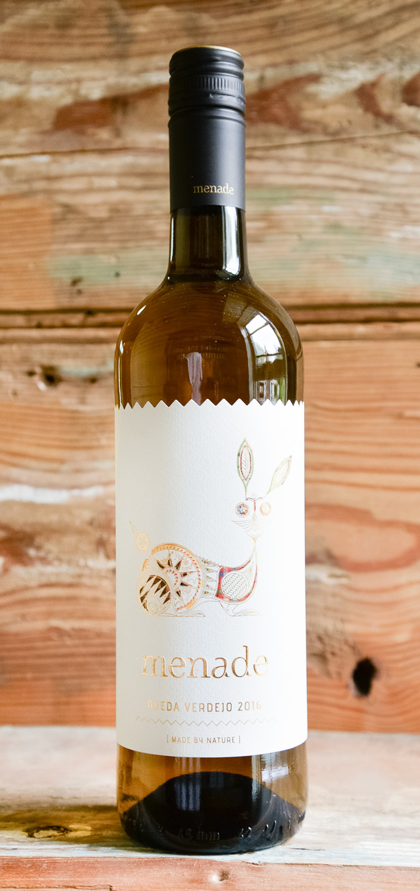 Menade Rueda Verdejo 2016 - Origin: SpainRetail: $15.95 | Sale $14.35The three siblings behind Menade are Marco, the viticulturalist, Richard, the winemaker and Alejandra managing sales and communications. The Sanz siblings agree that organic farming, a high proportion of old vines grown on chalk, and careful harvesting at night are essential to produce vibrant and fresh wines. This Verdejo is as pure as it gets - the grapes are coming from distinct parcels in and around Rueda that grow in pebbly clay, and calcareous soils. On the nose, there is a concentration of varietal and mineral aromas -- notes of fruit mix with more herbaceous aromas of laurel, fennel and thyme. This Verdejo is dry, balanced and round with volume on the palate. There is a certain bitter touch, typical of the varietal and the natural acidity holds a long and elegant finish.100% Verdejo Organic