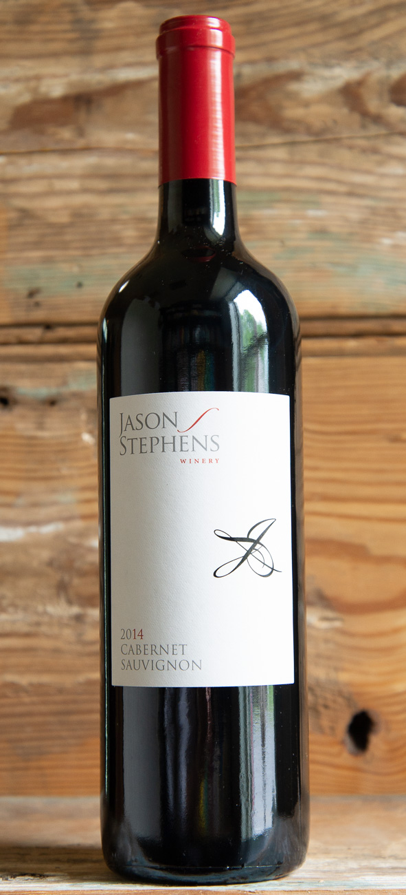 Jason Stephens Cabernet Sauvignon 2014 - Origin: CaliforniaRetail: $23.95 | Sale $21.55Gilroy, California is known as the garlic capital of the world, but also happens to be a particularly good environment for growing grapes (which have been thriving there for over 300 years). Aromas of black pepper, fresh marjoram, and dried strawberry aromas welcome you into the glass. The palate shows an herbal backbone full of peppercorns and oregano, giving depth to the snappy black-raspberry flavors. This wine finishes with good length and enough fine tannin to stand up to steak, but not get in the way of solo sipping.76% Cabernet Sauvignon, 10% Merlot, 6% Petit Verdot, 4% Malbec, 4 % Cabernet Franc