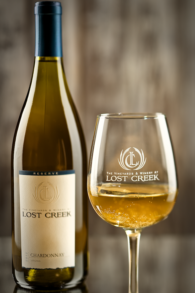 Lost Creek Chardonnay 2017 - Origin: VirginiaRetail: $23.95 | Sale: $21.55This boutique winery, nestled in the rolling hills of Northern Virginia just outside of Leesburg, has been in the works since 1998 on 16 acres of land. Whole-cluster pressed and then barrel-fermented in French Oak followed by 10 months of barrel aging with 20% new oak, this Burgundian-style Chardonnay is made from 100% estate grown grapes and owner/winemaker produced. It's a wonderfully balanced Chardonnay that walks the line between a fresh-fruited, low-oak style and a creamy, barrel-fermented style. An ideal pairing with salmon, Manchego cheese, or white pizzas.100% Chardonnay