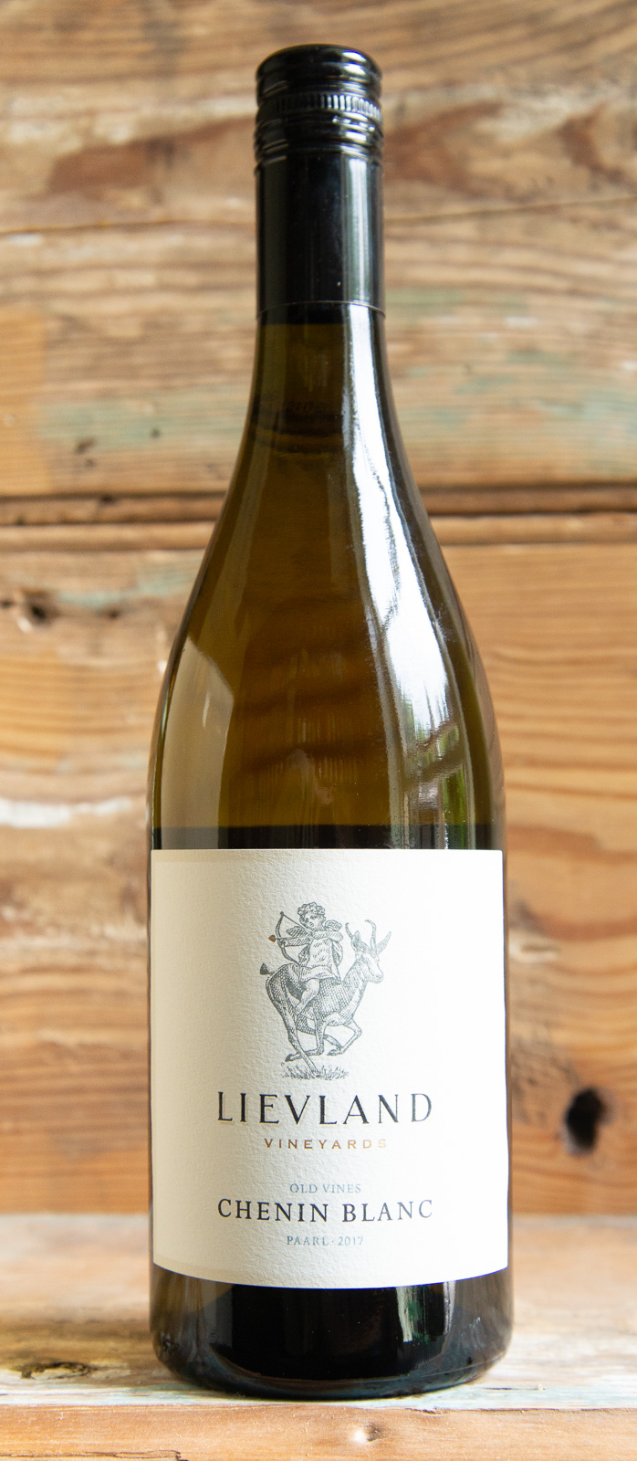 Lievland Vineyards Chenin Blanc 2017 - Origin: South AfricaRetail: $22.95 | Sale: $20.65Lievland's history dates back to 1715, when the original farm was granted to the ex-soldier Jurie Hanekom. Lievland lies on the western slopes of the Simonsberg mountains between Stellenbosch and Paarl, two of the most prominent wine-growing areas in the Cape. This wine is representative of the versatility of old vine Chenin Blanc. Notes of white peach, citrus and pineapple welcome you into the glass. The palate has a rich and ripe mouthfeel balanced with vibrant acidity which contributes to the lingering zesty finish. The freshness and complexity of this wine will enable it to develop gracefully over the next 5 -7 years. This Chenin can easily be enjoyed on its own, but can also complement dishes with pork or a creamy seafood recipe.100% Chenin Blanc