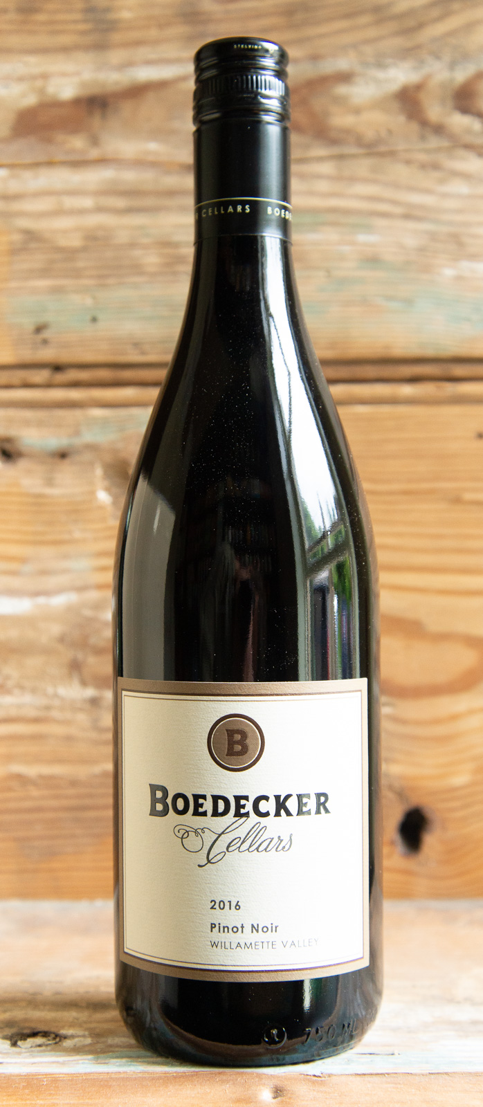 Boedecker Pinot Noir 2016 - Origin: OregonRetail: $27.95 | Sale $25.15Boedecker Cellars, owned by husband-and-wife team of Stewart Boedecker and Athena Pappas, is a full-blown urban winery that churns out some of Oregon's best pinot noir. The 2016 Pinot Noir draws you in with heavy aromas of sour cherry and cranberry, with undertones of wet earth and mushrooms. On the palate you will find these same red fruit flavors, which lead into a smooth, complex finish. Significant time in seasoned French oak contributes to the complexity and structure of this wine, while also adding a very interesting smoky component on the nose and palate.100% Pinot Noir