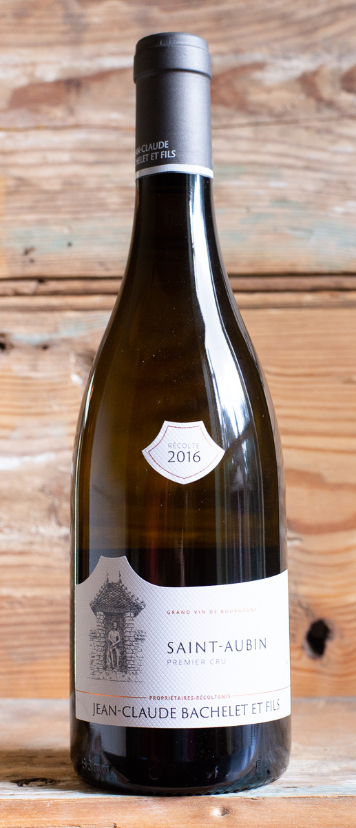 Jean Claude Bachelet Saint-Aubin Blanc Premier Cru 2016 - Origin: FranceRetail: $65.95 | Sale: $59.35The Bachelet family has been making wine in Burgundy since the 17th century. Today, Jean-Claude and his sons, Benoît and Jean-Baptiste continue the tradition. They are located in the small village of Gamay, tucked deep into the hills of Saint-Aubin. The family philosophy of respecting the individual character of each terroir and their traditional approach to winemaking carries on today. Long and rigorous work in their biodynamic vineyards, with a strong attention to detail, results in fine fruit reaching the cellar. Once there, a non-interventionist approach is followed, allowing each wine to express its own character. The use of new oak is restricted to just 10%, preventing the gentle subtleties from being overpowered. The white wines of Saint-Aubin have a remarkable ability to age for up to 15 years. In the glass, this Premier Cru Burgundy is shiny gold with green highlights. The nose exudes aromas of white fruit and floral notes with a hint of delicate oak. The palate possesses a beguiling sense of vibrancy with beautifully delineated flavors. The dry finish is infused with citrus and minerals. This is an elegant and harmonious wine that will pair beautifully with white meats, seafood, or strong cheeses.100% Chardonnay | Biodynamic