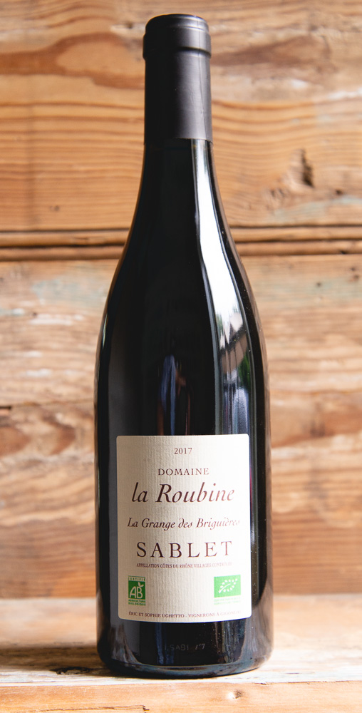 Domaine de la Roubine La Grange de Briguieres 2017 - Origin: FranceRetail: $20.95 | Sale: $18.85La Grange de Briguieres Sablet is made by Eric and Sophie Ughetto at their tiny base in the southern Rhone village of Gigondas. The nose is full of pure raspberry and wild strawberry aromas followed by a distinct garrigue herb note. The palate has a silky texture with raspberry fruits and a deeper note of blueberry and dark cherry balanced by fresh acidity and a ferrous and granitic minerality. This is not your average Cotes du Rhone, and this wine achieves greater depth without a sense of 'heaviness'. The finish is lovely with a savory note of bay leaf and thyme combined with a beautiful expression of fruit.70% Grenache | 25% Syrah | 5% CinsaultOrganic.