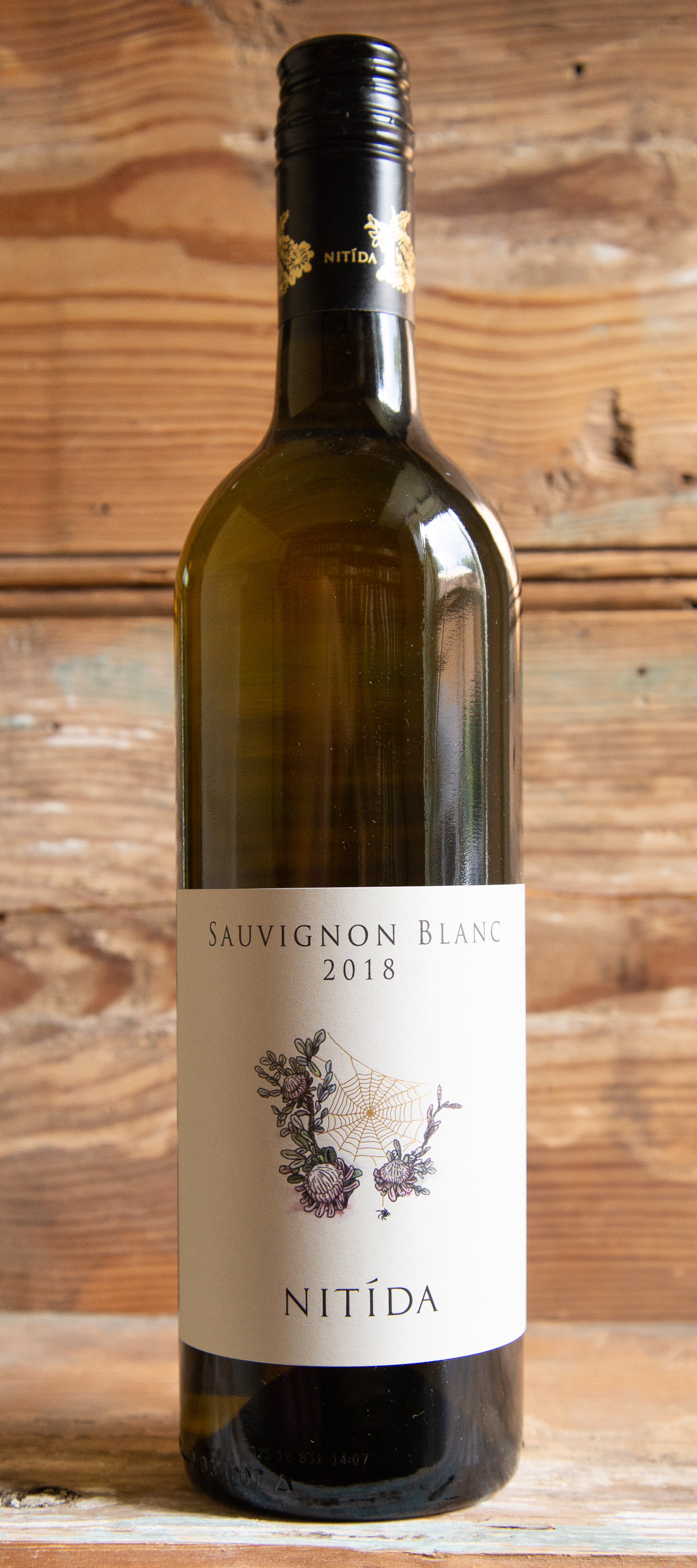 Nitida Sauvignon Blanc 2018 - Origin: South AfricaRetail: $18.95 | Sale: $17.05This small Durbanville property houses one of South Africa's most successful small wine cellars while also maintaining a flock of 50 sheep, 2 cows and a sheepdog. The grapes were harvested in 25 different pickings over a time span of 6 weeks. This gives them the variety of building blocks to create a complex Sauvignon Blanc that reflects the riper tropical fruit flavors of the 2018 harvest, with green undertones that are traditional from the Durbanville terroir. There is a superb balance of fruit, delicious minerality and perky acidity. Sip your first glass with oysters on the half shell topped with a shallot mignonette -- their brininess is the perfect pair. This wine is also a great choice for a light supper or lunch with a loaded Nicoise salad.100% Sauvignon Blanc