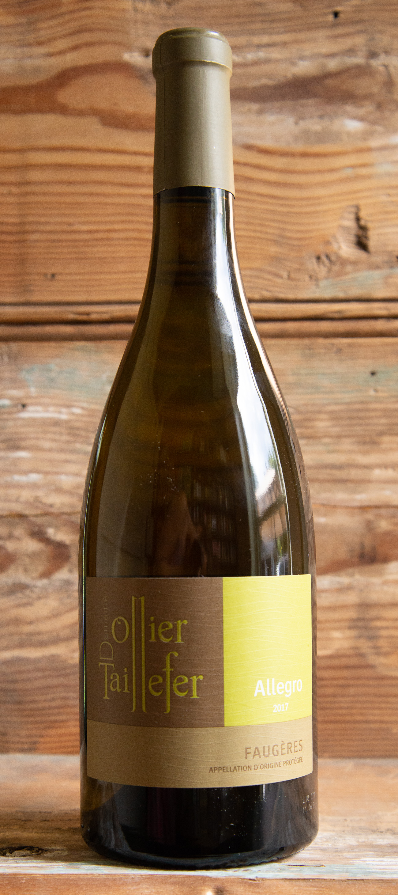 Domaine Ollier-Taillefer Faugères Allegro 2017 - Origin: FranceRetail: $28.95 | Sale: $26.35Only 2% of what Faugères produces today is white wine, making this a rare find. What sets Faugères apart amid the labyrinth of Languedoc appellations are two things: its geology of schist, and its high elevation. Relative to other Languedoc appellations, it's also small and rather stunningly compact -- being one of more than twenty appellations in Languedoc but owning less than 1% of the total vineyard surface. This wine pours with an intense lemon-yellow and straw color, shining with gold hues. Lively apricot and fresh peach aromas welcome you into the glass with an elderflower floral edge and a wealth of honey. The palate is round and oily, dry with a good crispy acidity, and underlining zesty lemon flavors. Orange peel and apple complete the profile of this lively fruity white, as well as bursts of ginger and fresh hazelnut.50% Roussanne, 50% Vermentino.Organic.