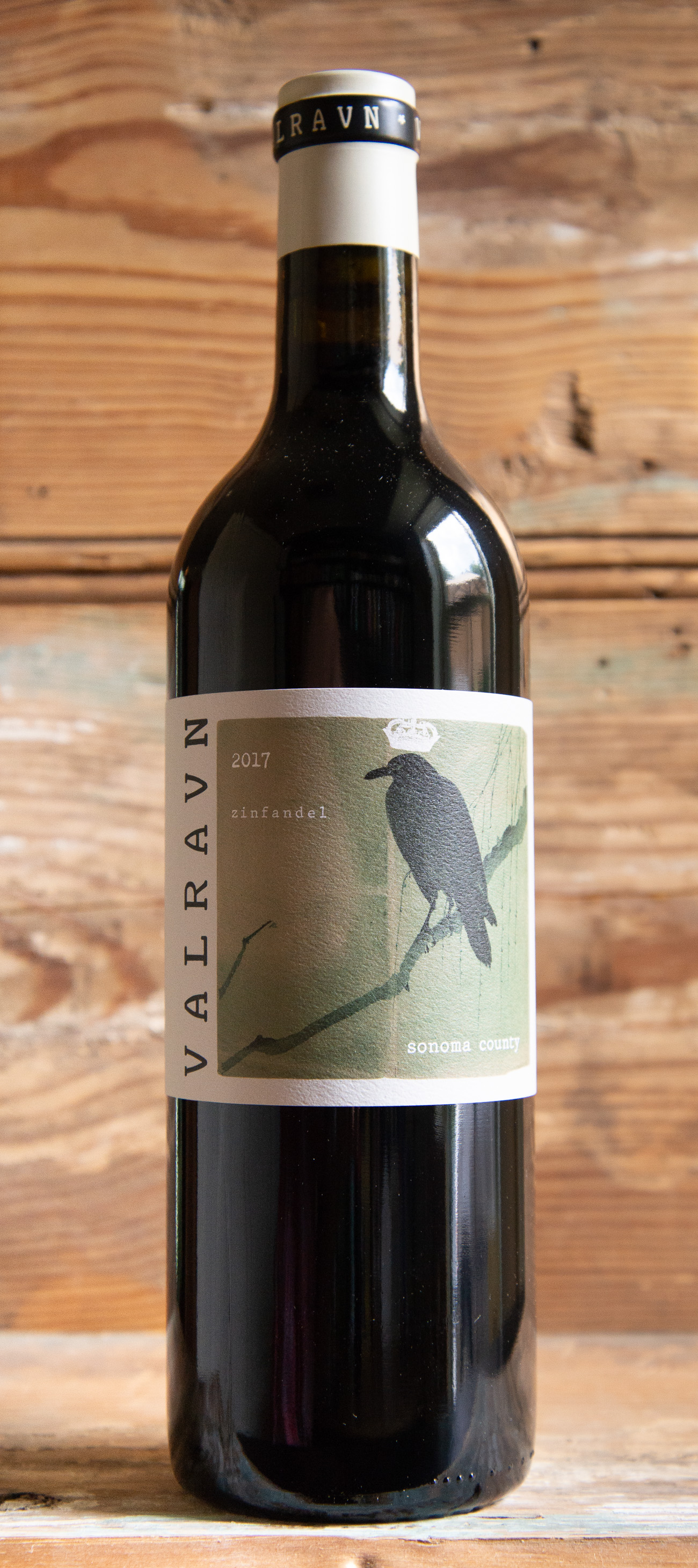 Valravn Zinfandel 2017 - Origin: CaliforniaRetail: $18.95 | Sale: $17.05Bright aromas of dark cherry and black raspberry with slight undertones of white pepper spice. The palate is warm with dark fruit flavors of blueberry, cassis, and blackberry compote which are complemented with briary notes and an energetic freshness. Strikes ideal balance of tannins, fruit and acidity. Great pizza wine! 100% Zinfandel