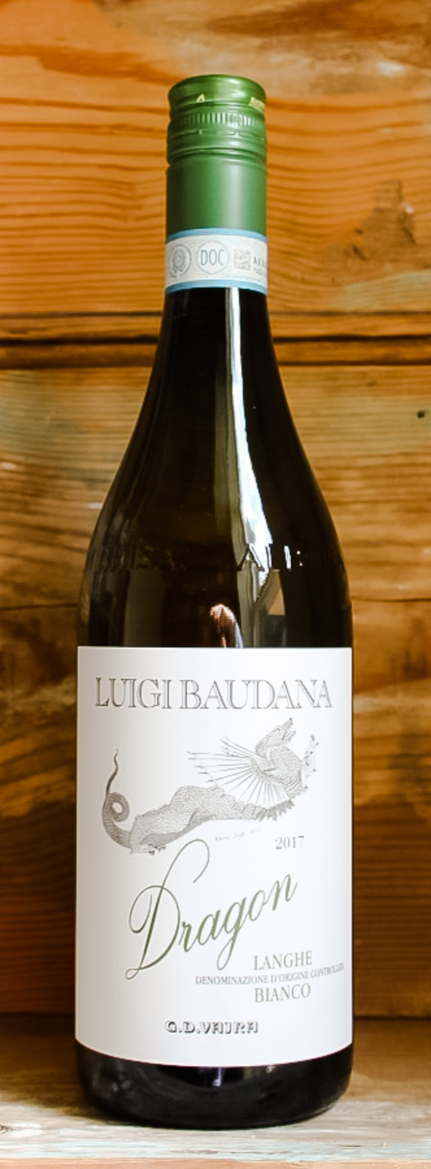 G.D. Vajra Luigi Baudana Dragon Langhe Bianco 2017 - Origin: ItalyRetail: $22.95 | Sale: $20.66This small estate is just four hectares of vineyard, located in Serralunge d'Alba, a commune in Piedmont. Their tiny cellar is situated in the village, while their vineyards are primarily in the 'crus' of Baudana and the highly regarded Cerretta. After 30 years running the winery, Luigi Baudana visited the Vajra winery incognito one day and was so impressed with the way they dealt with people and communicated their philosophy that he rang Aldo Vajra soon afterwards to ask if he would be interested in buying his estate. A deal was soon done, and the Vajra family have run this estate alongside Luigi and his wife Fiorina ever since. In the glass this white field blend shows a beautiful straw yellow color, very intense and luminous. The nose is full of floral sensations, enriched with nuances of peach, apple, lemon, and a touch of fresh grass. On the palate it is light-bodied and savory with a pleasant freshness.Chardonnay | Sauvignon Blanc | Riesling | Nascetta