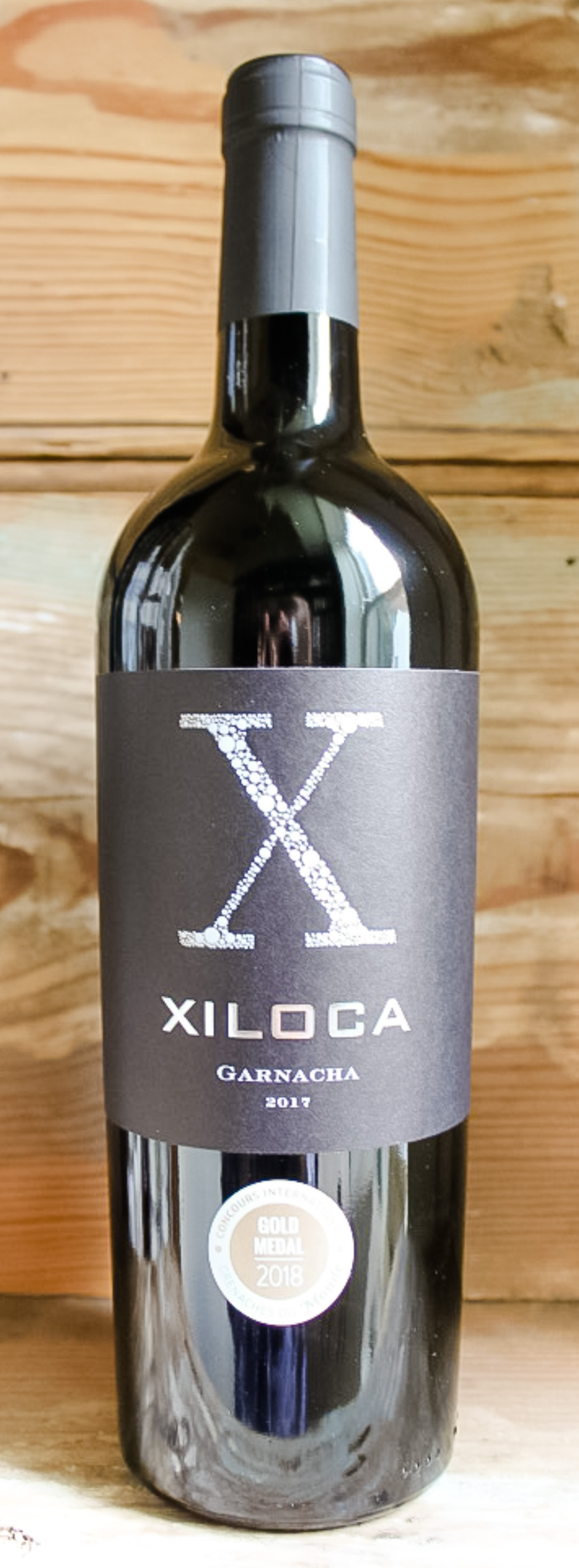 Xiloca Garnacha 2017 - Origin: SpainRetail: $14.95 | Sale: $13.45Intense blackberry color and aroma jump from the glass. The freshness of the integrated tannins invite you in for a second sip. The intensity continues in a mouth-filling palate and a lingering fruit and mineral finish. Calatayud is a region a short distance from Spain's most famous region, Rioja. This garnacha is produced from 40-100 year old organically farmed vines. Its fresh on the palette with black cherry, leafy, and licorice flavors. 100% Garnacha