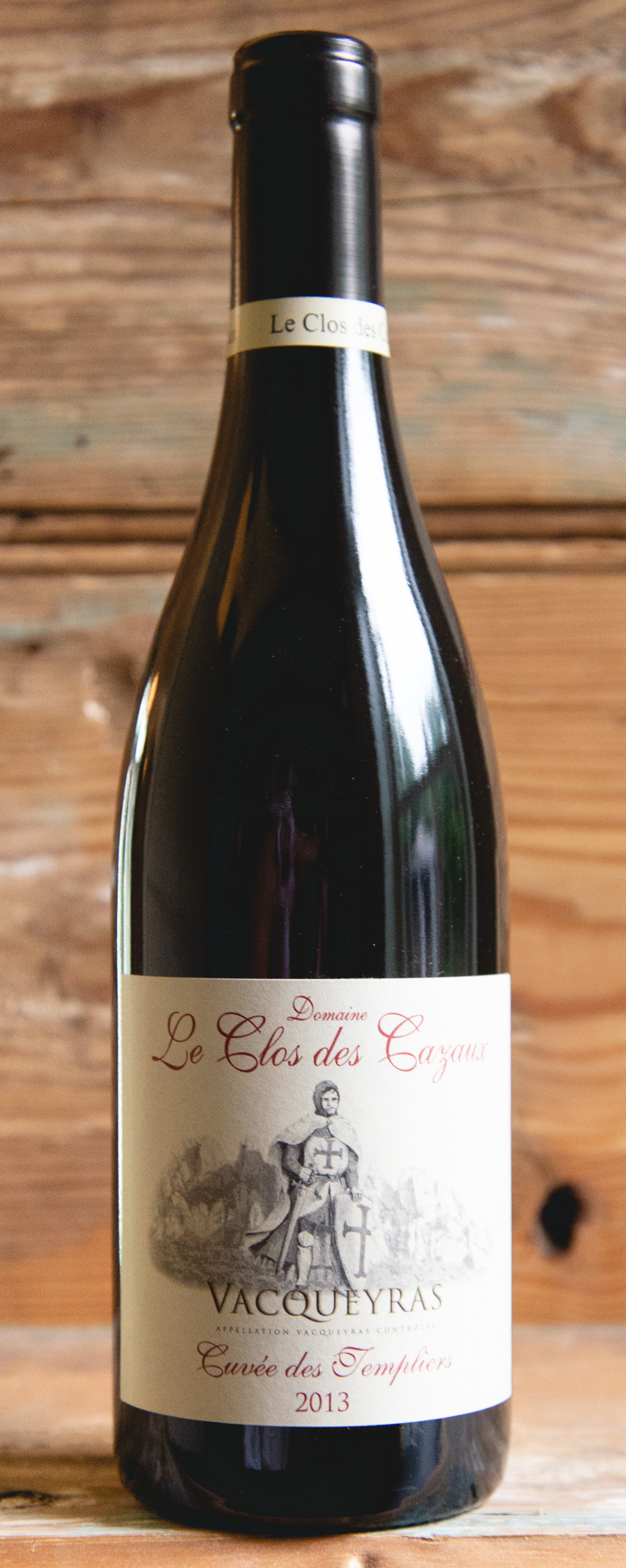 """Le Clos des Cazaux """"Cuvée des Templiers"""" Vacqueyras 2013 - Origin: FranceRetail: $25.95   Sale $23.35The Archimbaud-Vache family - owners of Clos des Cazaux - is one of the oldest families in Vacqueyras, with roots dating back to 1791.From vines planted in 1934, this is an atypically spicy blend with peppery, blackberry fruit, and garrigue notes. Deeply pitched black and blue fruit are enlivened by smokey mineral and peppery spice accents. The balanced and lasting tannins of this wine make an excellent accompaniment to grilled meats and vegetables.50% Syrah   50% Grenache"""