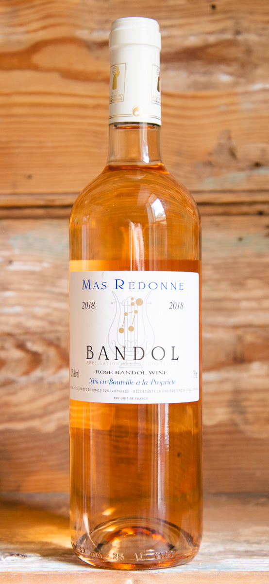 Mas Redonne Bandol Rosé 2018 - Origin: FranceRetail: $24.95 | Sale: $22.45The Tournier family established this estate in 1982, renovating it from an old farm in La Cadiere-d'Azur. They farm organically, focusing on mourvedre, which they blend with a little Cinsault and Grenache for this textbook Bandol rosé. It's savory, with mourvedre's earthy black fruit flavors, a little herbaceous and peppery, saline and firm. Pair with a classic summer lunch at Locke Store! 55 Mourvedre | 35 Cinsault | 10 Grenache Organic | 90 Points Wine & Spirits