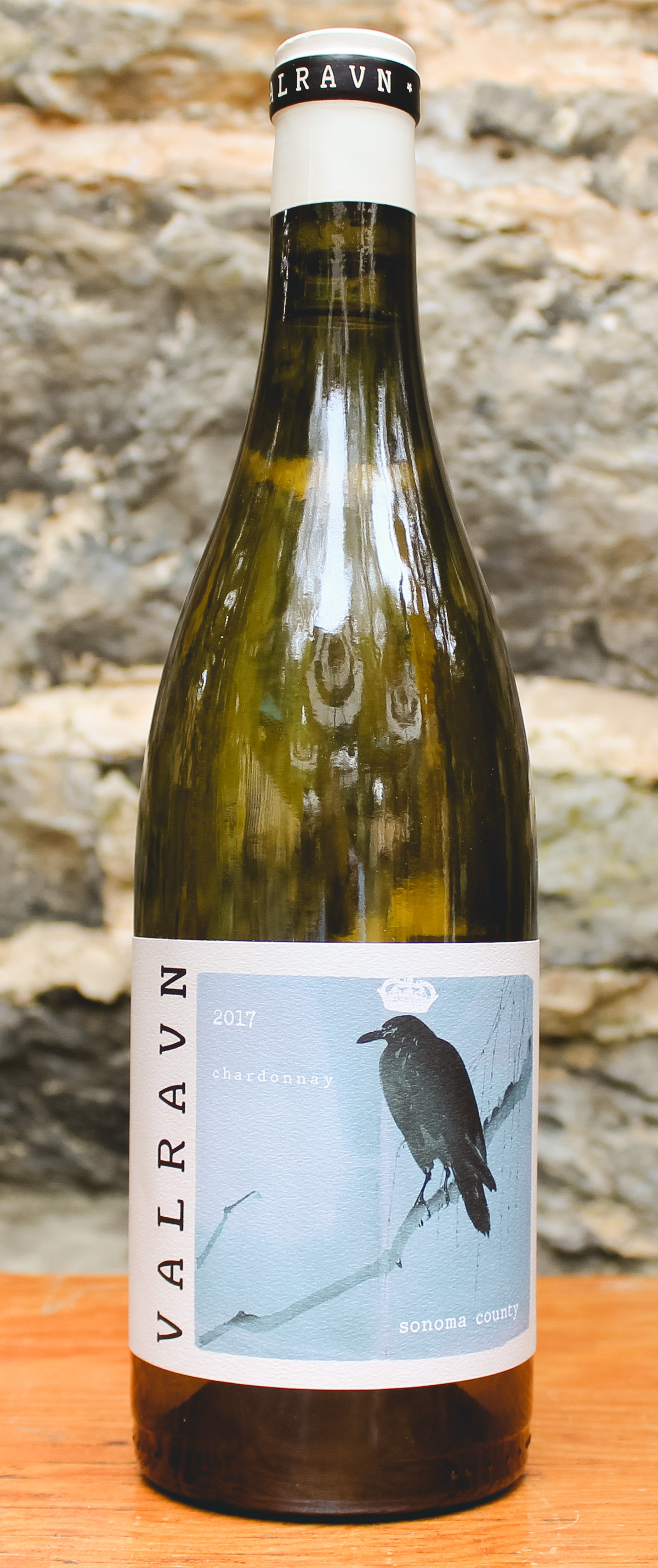 Valravn Chardonnay 2017 - Origin: California Retail: $23.95 | Sale: $21.55Cold climate vineyards in the Sonoma Coast provide a core of minerality, ripe peach, and apple with a touch of citrus. These fresh notes are balanced by richer flavors of toasted hazelnuts, and ripe pineapple that come from the barrel fermented Russian River component. Overall, the Valravn Chardonnay walks the delicate line between high toned freshness, and the more powerful flavors of barrel fermented Chardonnay. This is a crowd-pleasing white and a great go-to for dinner parties with family or friends!Chardonnay