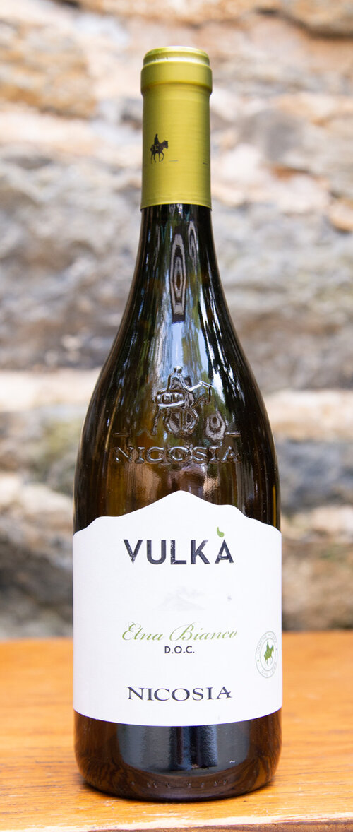 Nicosia Vulka Etna Blanco 2017 - Origin: ItalyRetail: $22.95 | Sale: $20.65Vulkà Etna Bianco is a blend of indigenous varietals that give an authentic expression of the terroir of Etna, and it is distinguished by its extraordinary freshness and elegance. The volcanic origin and the altitude of the vineyards give this wine a great minerality and unique character. Delicately scented, this blend offers subtle aromas of yellow wildflower, orchard fruit and wild herb. Mirroring the nose, the crisp, linear palate offers yellow apple, Bartlett pear and a light salty note alongside bright acidity.60 Carricante | 40 Catarratto