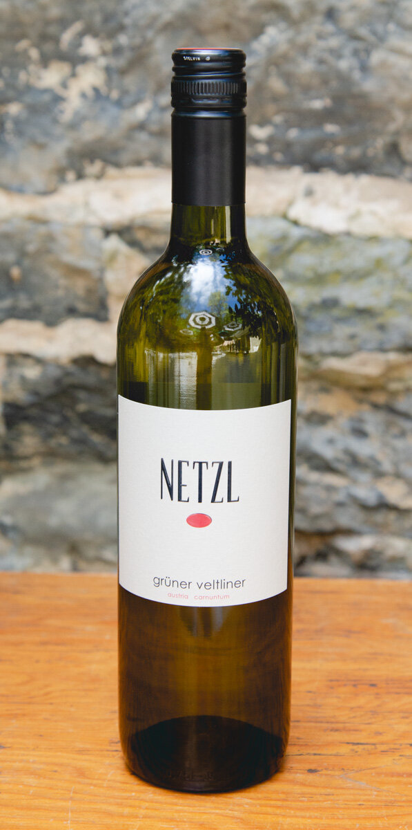 Netzl Grüner Veltliner 2017 - Origin: AustriaRetail: $13.95 | Sale: $12.56Netzl is a small, family run estate with only 26 hectares of vines. The vineyards are cooled by the chill winds of the nearby River Daub allowing the intense aromas and acidity of the Grüner Veltliner grapes to be preserved. With typical varietal aromas of green apples and stone fruits, this wine maintains its mineral edge with a fresh and balanced finish.Grüner Veltliner