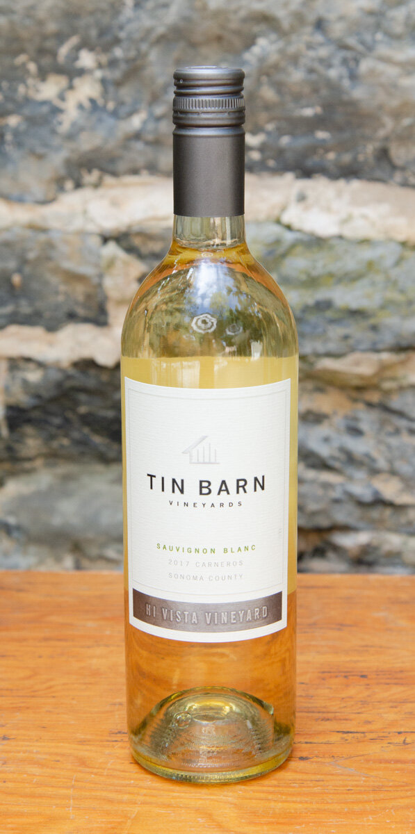 Tin Barn Sauvignon Blanc 2017 - Origin: CaliforniaRetail: $19.95 | Sale: $17.95Featuring grapes sourced from Hi Vista Vineyard in Carneros, this cooler climate Sauvignon Blanc produces a crisp acidity with aromas of citrus and melon and a rich mouthfeel. This fruity and refreshing wine is meant to be shared amongst friends. Enjoy with a light cheese plate, salads, or your favorite fish.Sauvignon Blanc