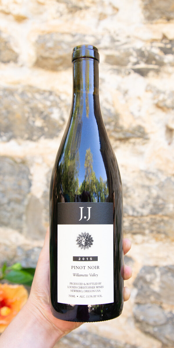 J Christopher J.J. Pinot Noir Willamette 2015 - Origin: OregonRetail: $27.95 | Sale $25.15The J. Christopher winery is located in Oregon's Northern Willamette Valley, in the Chehalem Mountains AVA. Owned by famed German winemaker Ernst Loosen, it is a small winery that specializes in Pinot Noir made using the traditional methods of Burgundy. This cuvée is a blend of selected barrels from several excellent vineyard sites in the red Jory clay of the Dundee Hills AVA. It shows the depth and power that are typical of this area, with classic savory and sanguine notes and a seamless acid structure. A serious value in Oregon Pinot. Pinot Noir | BIODYNAMIC